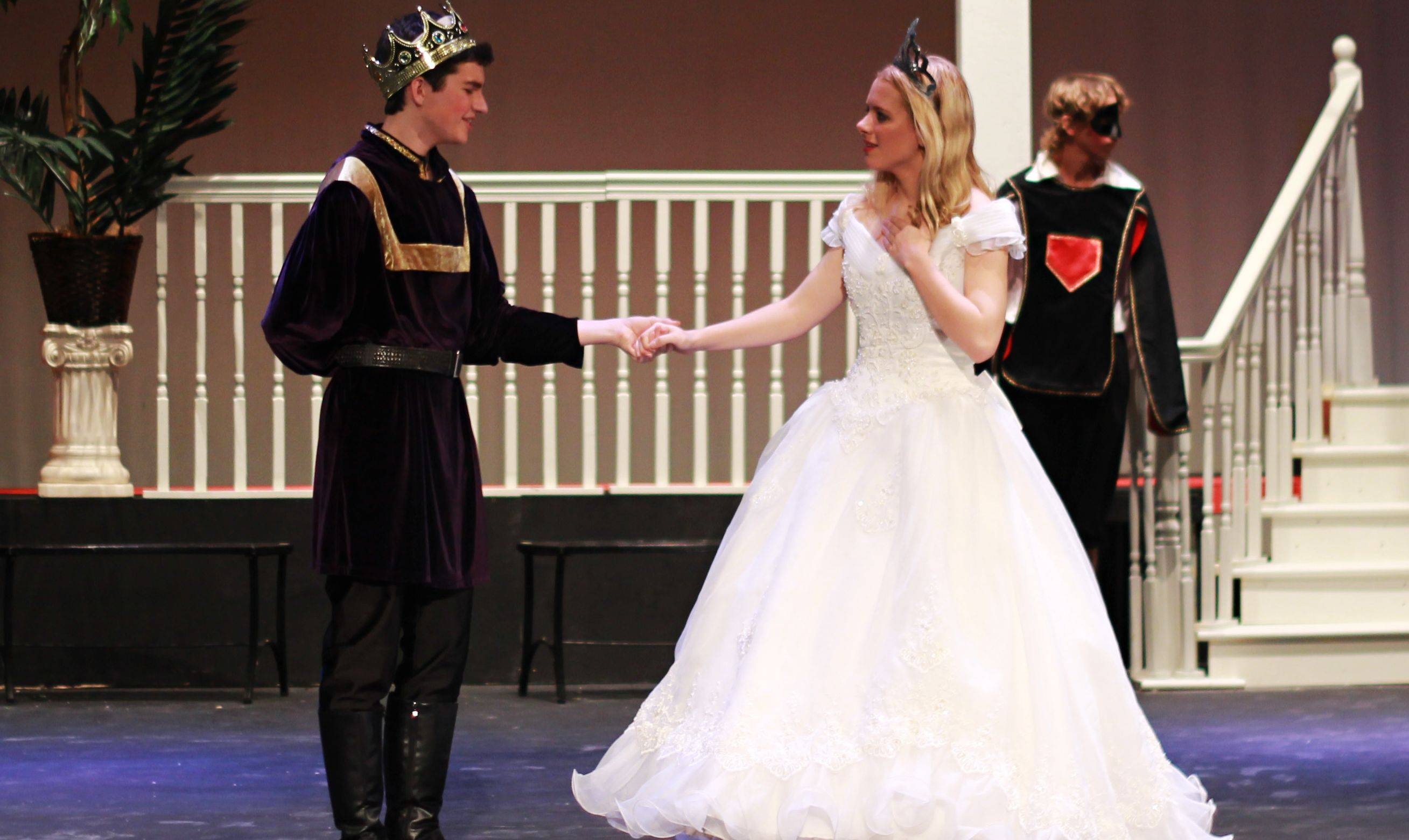 "Spence Bingham is the prince and Emily Marazzo is Cinderella in the Huntley High School production of ""Cinderella."" Here they dance at the ball during a rehearsal."