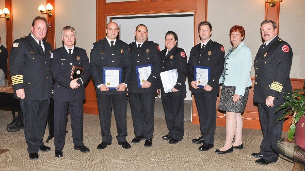 Among those on hand this week when Mount Prospect honored some of its firefighters for their service to the department, as well as the community as a whole, were, from left, Fire Chief John Malcolm, firefighter/paramedic Dale Steward, paid-on-call firefighter Scott Ginsberg, firefighter/paramedic Mike Hayes, paid-on-call firefighter Bettina Heller, firefighter/paramedic Kevin Swat, Mayor Arlene Juracek and Deputy Fire Chief Henry Dawson.
