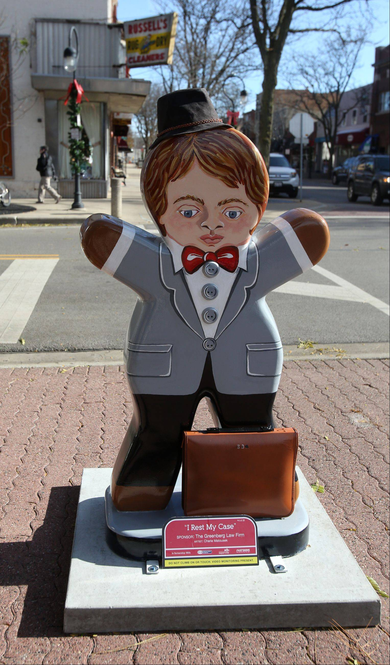 "Artist Cherie Matousek's gingerbread sculpture, titled ""I Rest My Case,"" occupies a downtown Naperville corner."