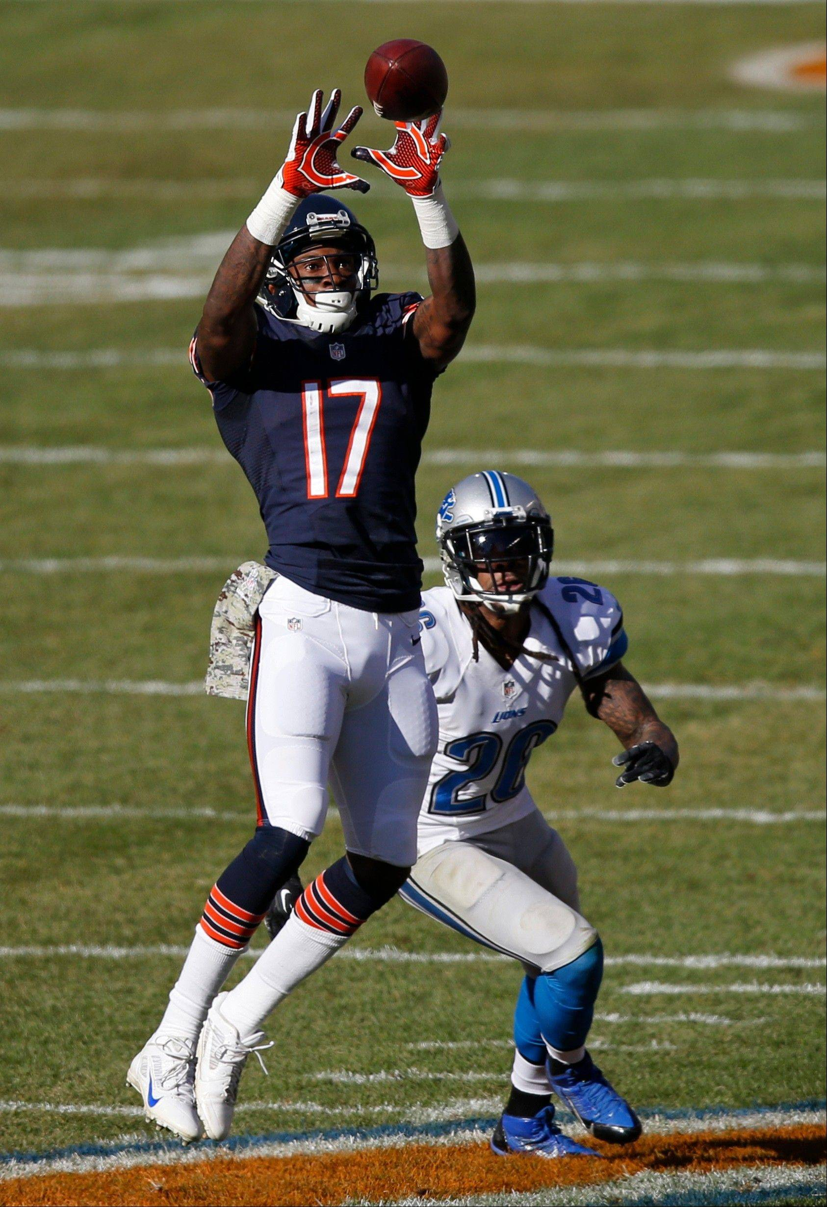 Bears wide receiver Alshon Jeffery (17) makes a catch in front of Detroit Lions safety Louis Delmas (26) during the first half of an NFL football game, Sunday, Nov. 10, 2013, in Chicago.