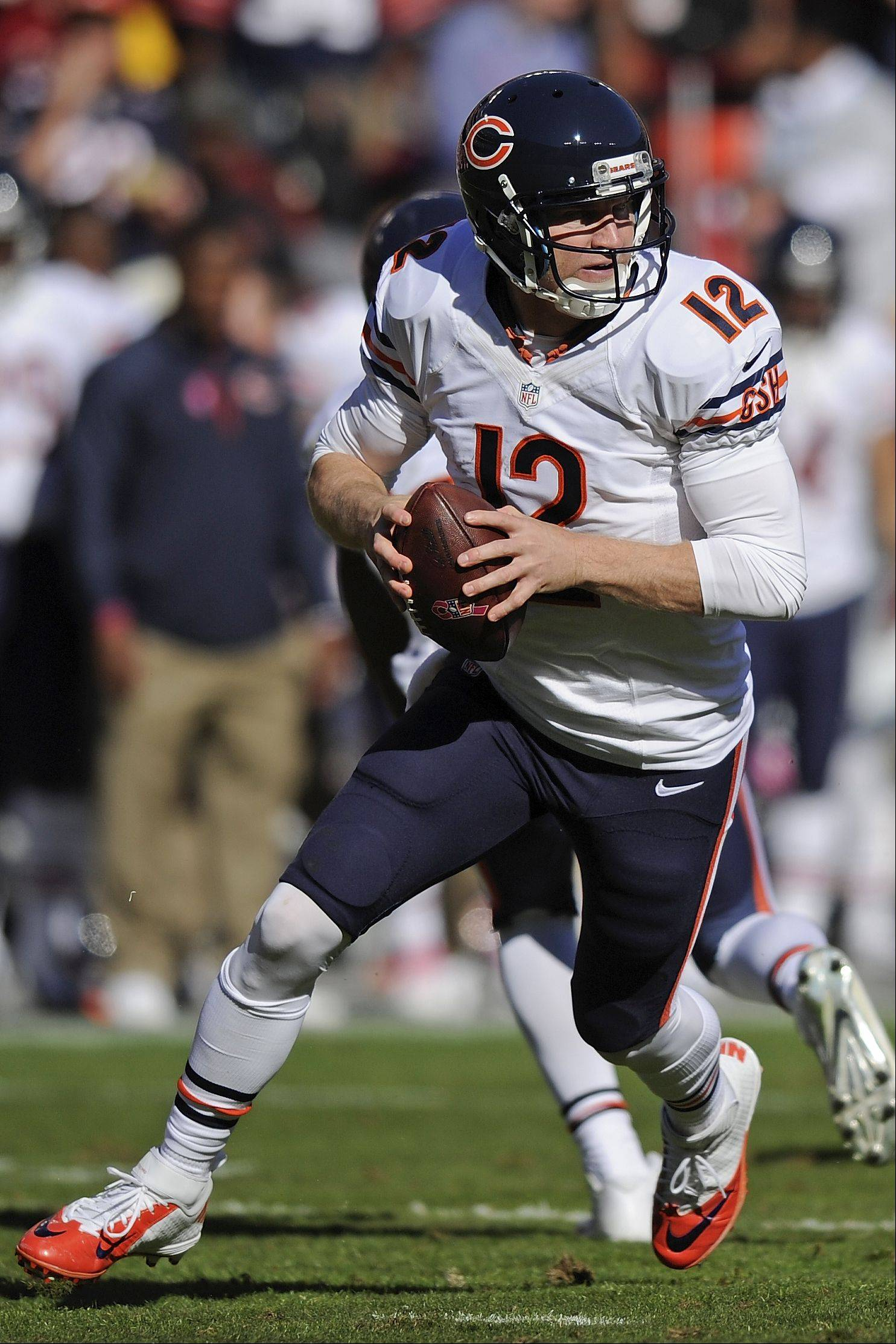 Josh McCown scrambles out of the pocket against the Skins on Oct. 20. McCown's solid play in part or all of the last three games likely means the well-traveled veteran quarterback will have a job somewhere in the NFL in 2014.