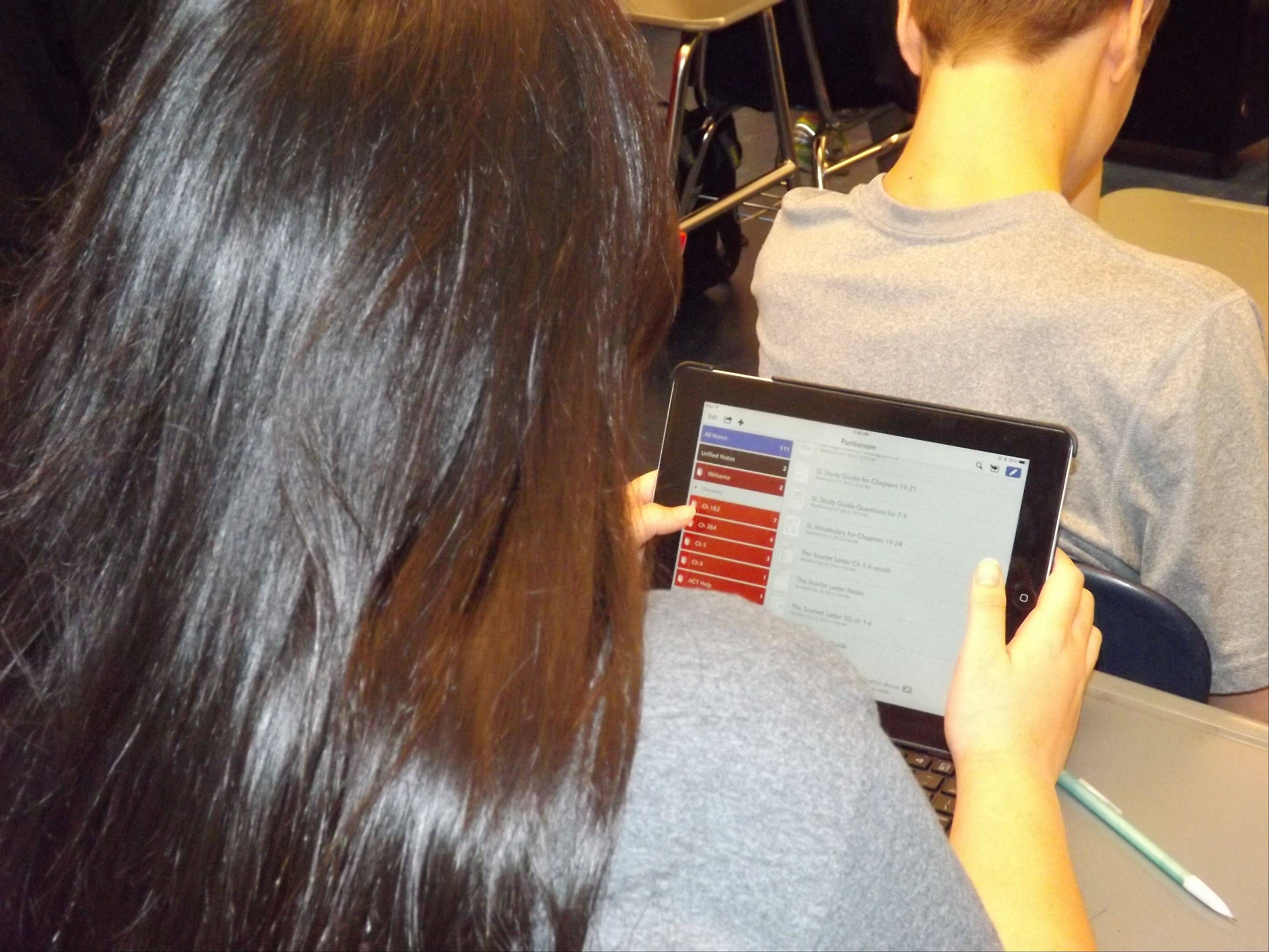 A student at Saint Viator High School uses an iPad in class. This is the first year St. Viator students are working exclusively with the iPad.
