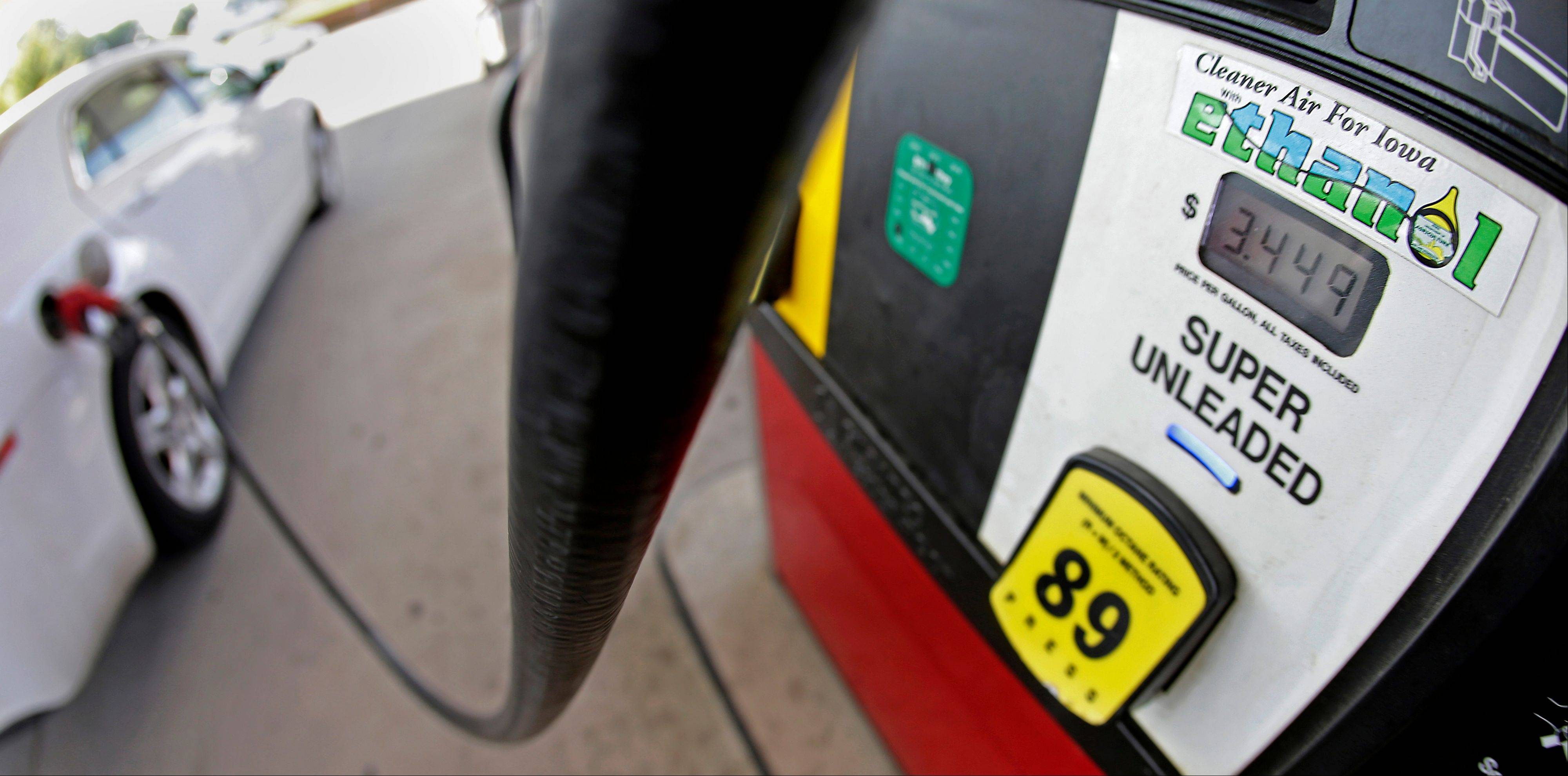 Associated Press/July 26, 2013 A motorist fills up with gasoline containing ethanol in Des Moines.