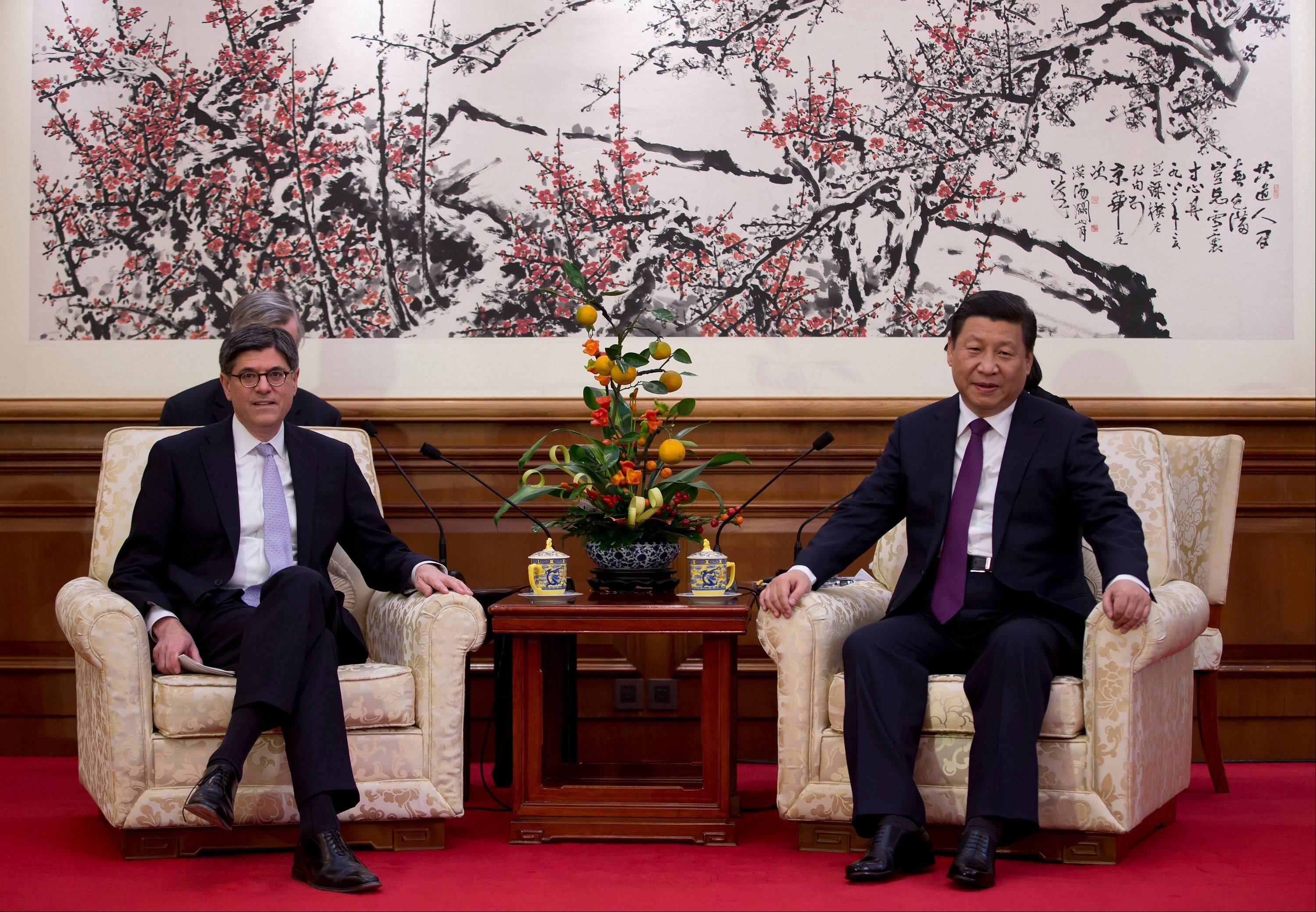 U.S. Treasury Secretary Jack Lew, left, and Chinese President Xi Jinping attend a meeting Friday at the Diaoyutai State Guesthouse in Beijing, China.
