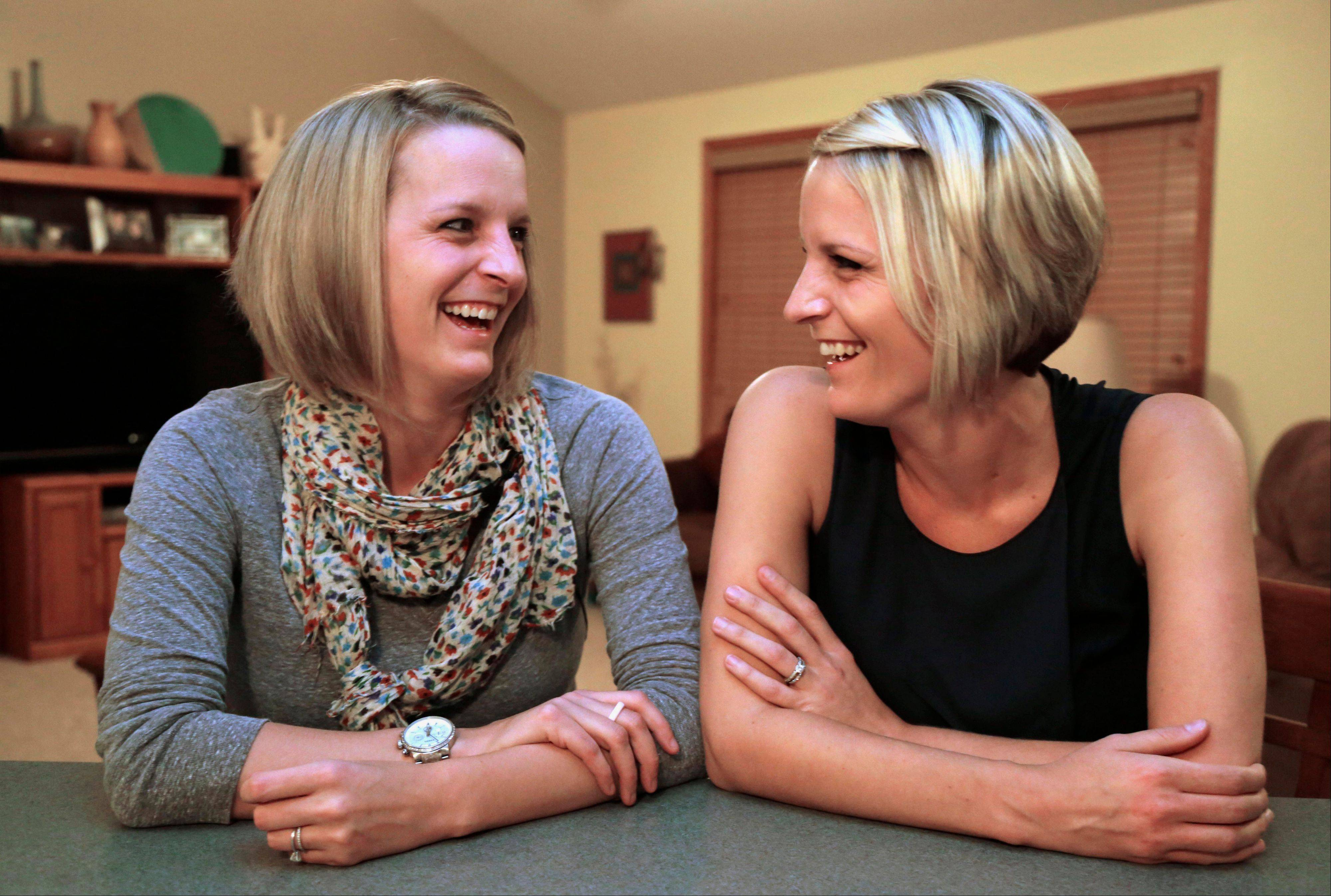 Identical twins Kristen Maurer, left, and Kelly McCarthy. The 34-year-old sisters from Crown Point, Ind., have shared a lot in their lives so when Kelly was diagnosed with breast cancer in 2011, she urged Kristen to get tested, too. Kristen also was diagnosed with breast cancer. Now the twins are sharing a medical rarity: Kristen donated skin and fat tissue for Kelly's breast reconstruction surgery.