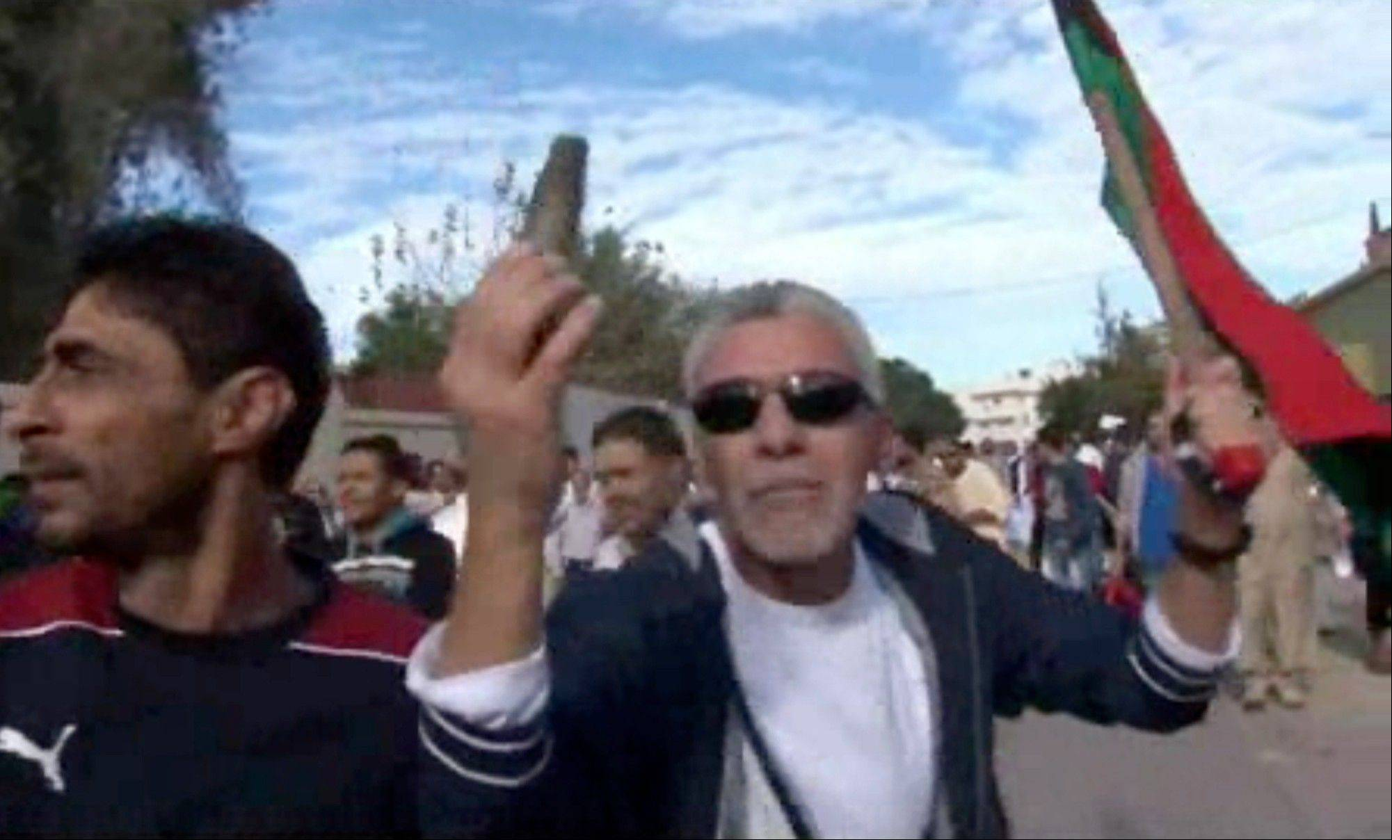 A protester holds up spent ammunition Friday in Tripoli, Libya after militiamen attacked peaceful protesters demanding the disbanding of the country�s rampant armed groups.