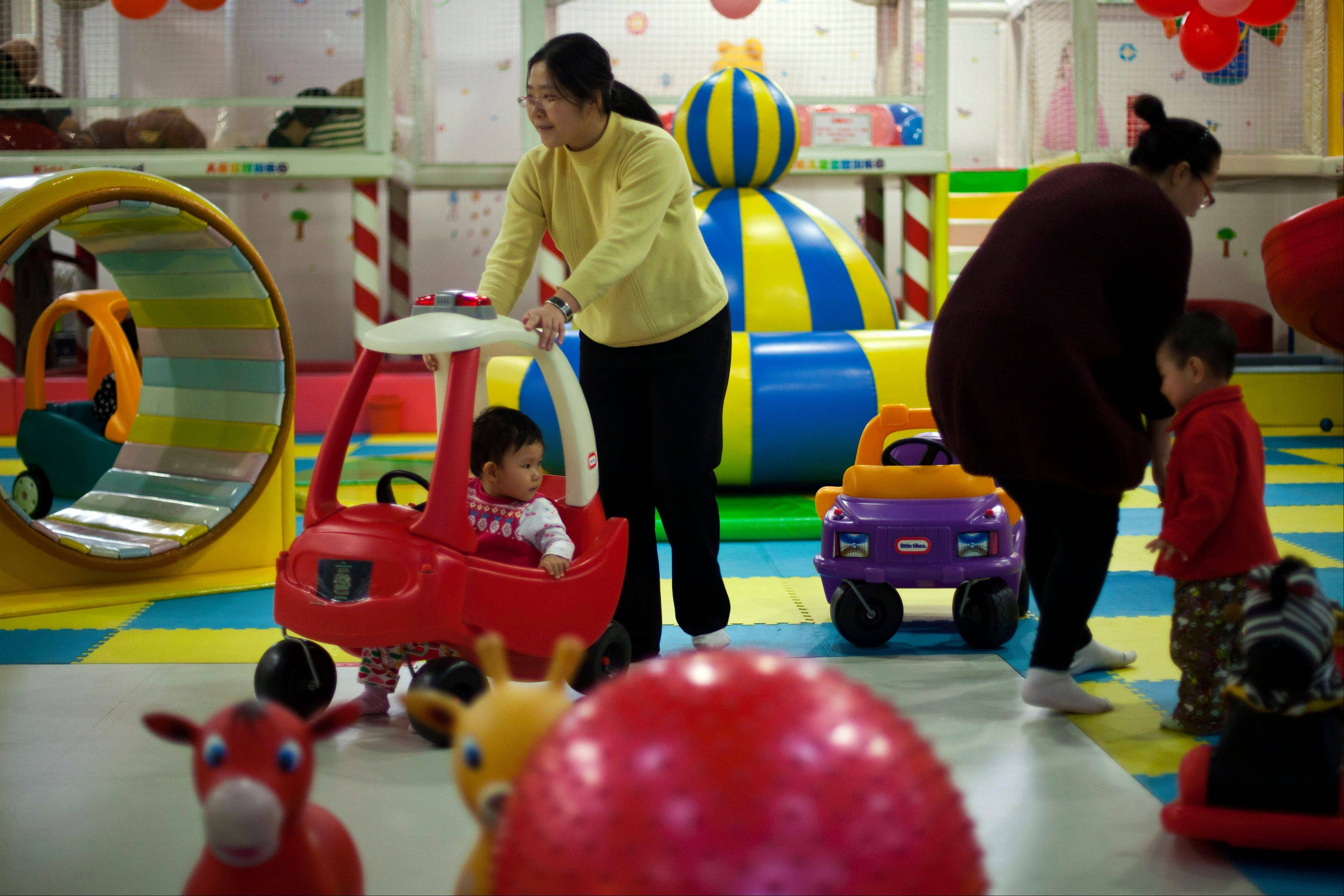 China to ease 1-child policy, abolish labor camps