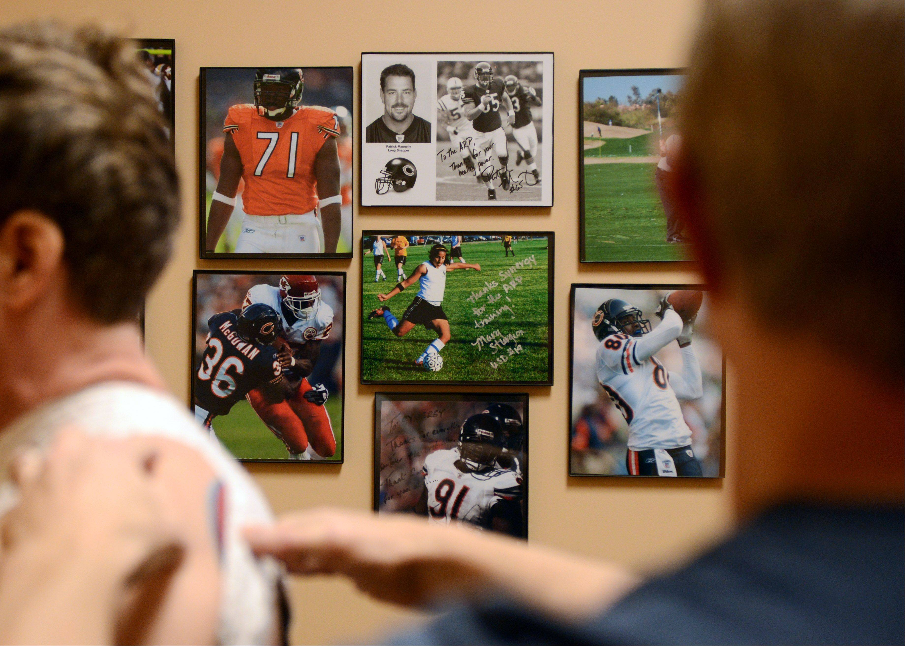 Photos of the professional athletes that John McNulty has worked with at Synergy Fitness adorn the walls at his Libertyville facility. McNulty started implementing the ARP in 2003, and his facility was the first in Illinois to use it. Today, many NFL players have their own ARP, which McNulty encourages them to use.