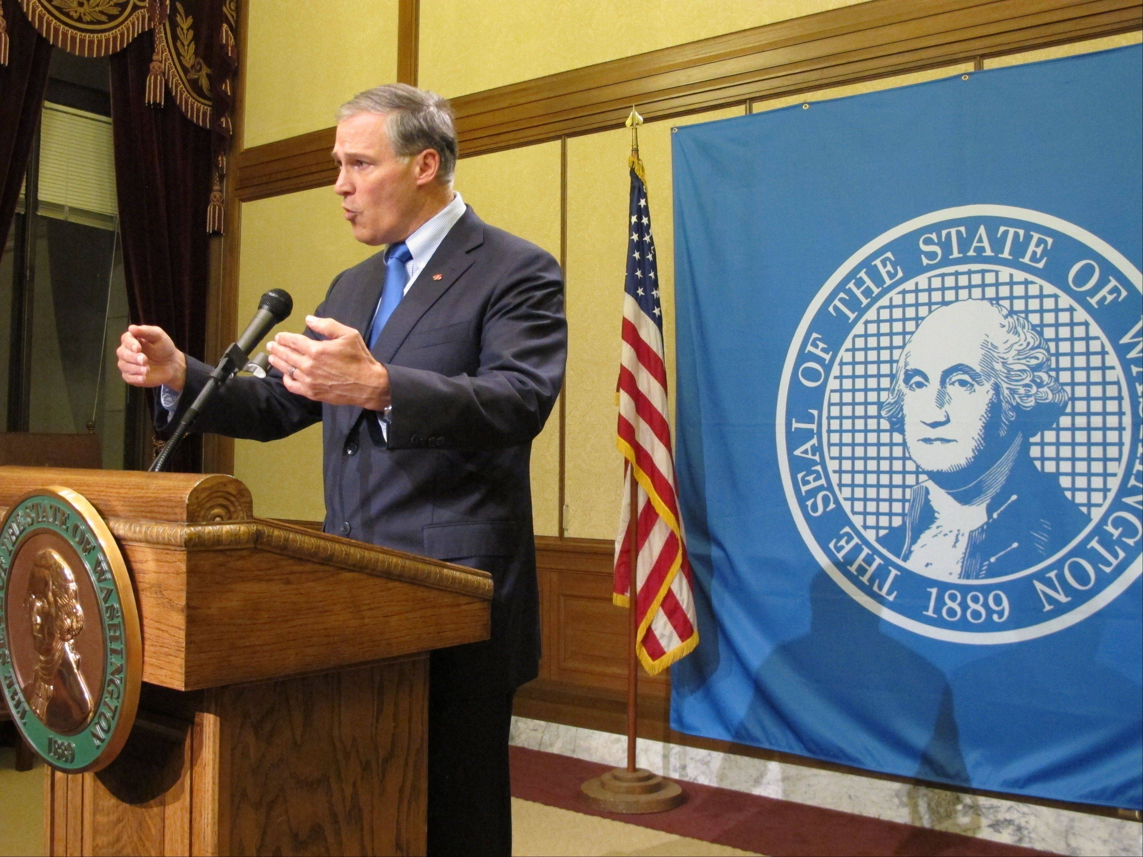 Gov. Jay Inslee speaks to reporters in Olympia, Wash. after Boeing machinists rejected an eight-year contract proposal Wednesday.