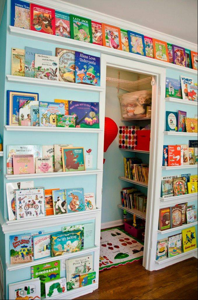 A book wall can be part of a kids' homework hub that can include a reading nook, too.