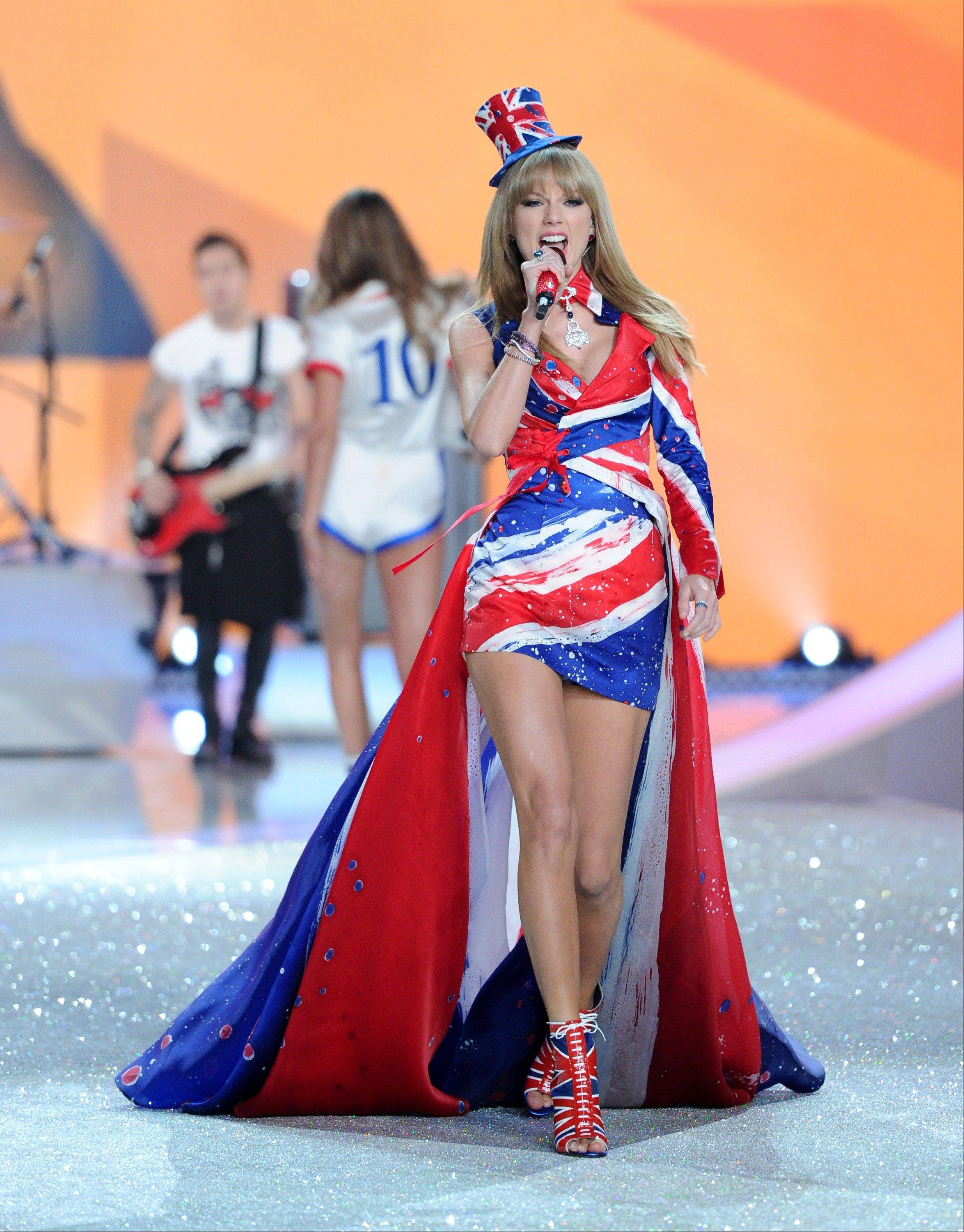 Singer Taylor Swift performs on the runway during the 2013 Victoria's Secret Fashion Show Wednesday in New York.