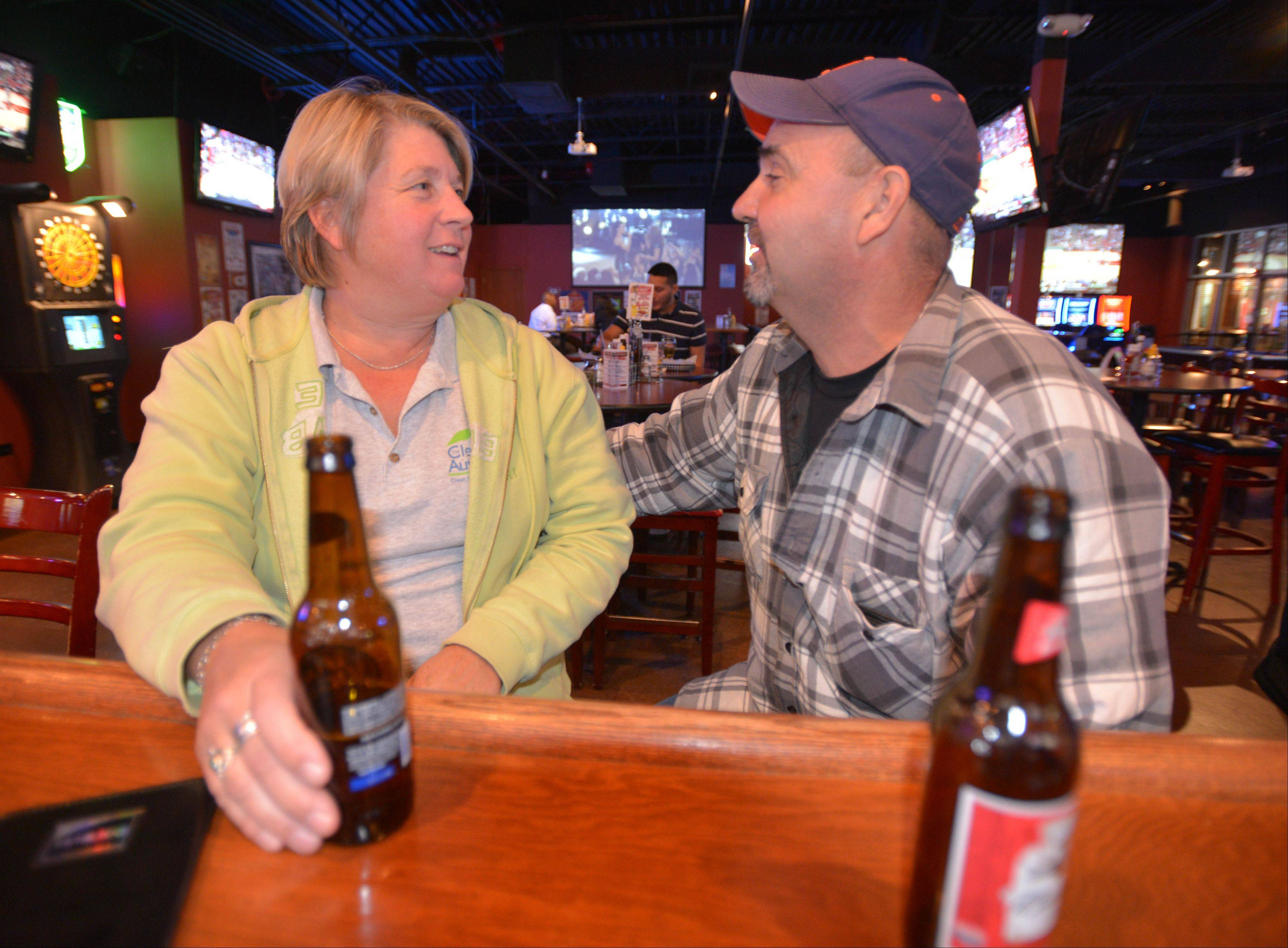 Shelli and John Giba of Aurora enjoy a beer at The Town Bar & Grill in Aurora.