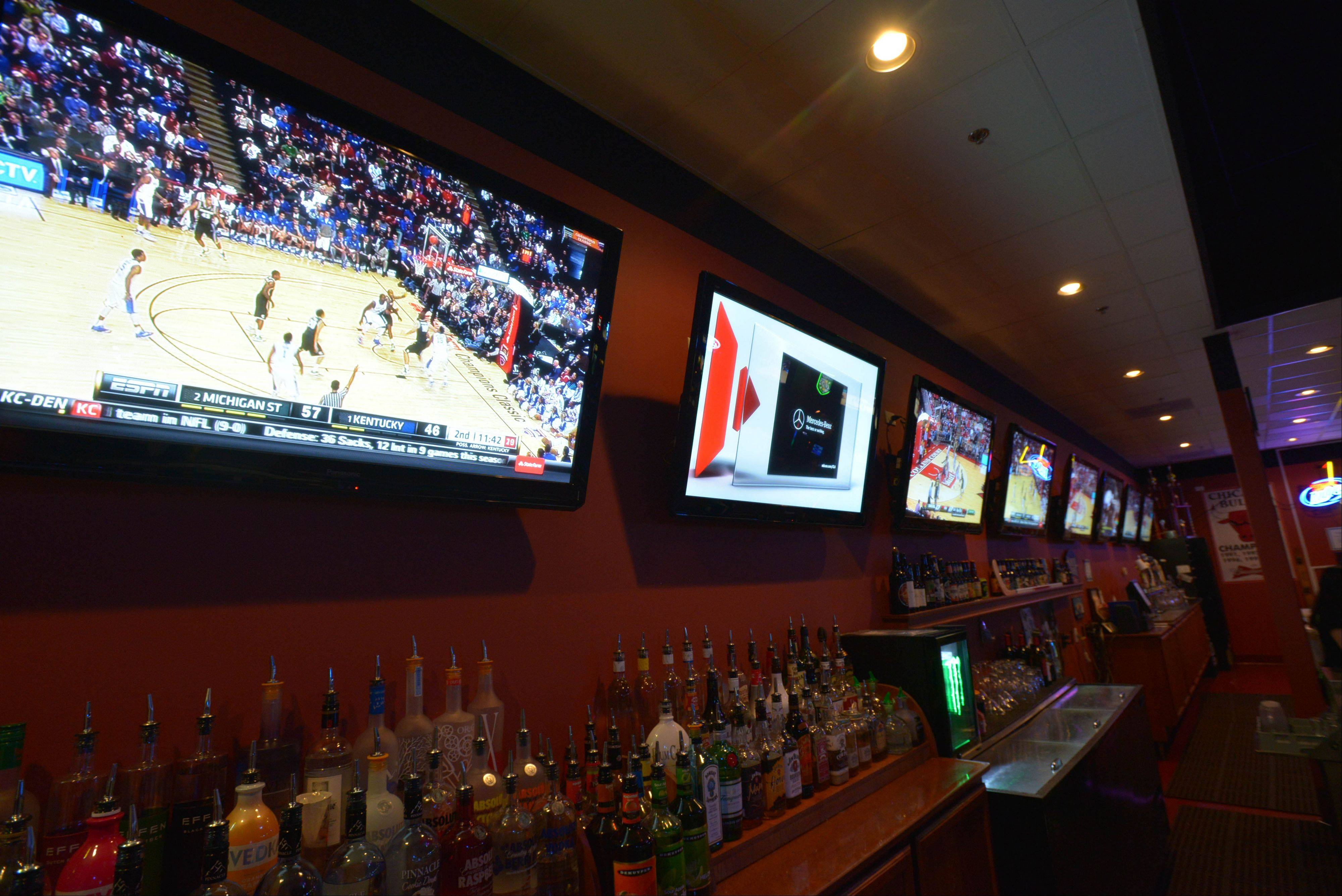 The Town Bar & Grill in Aurora has 20 TVs including three projector screens in back, which show football, hockey and baseball games and UFC fights.