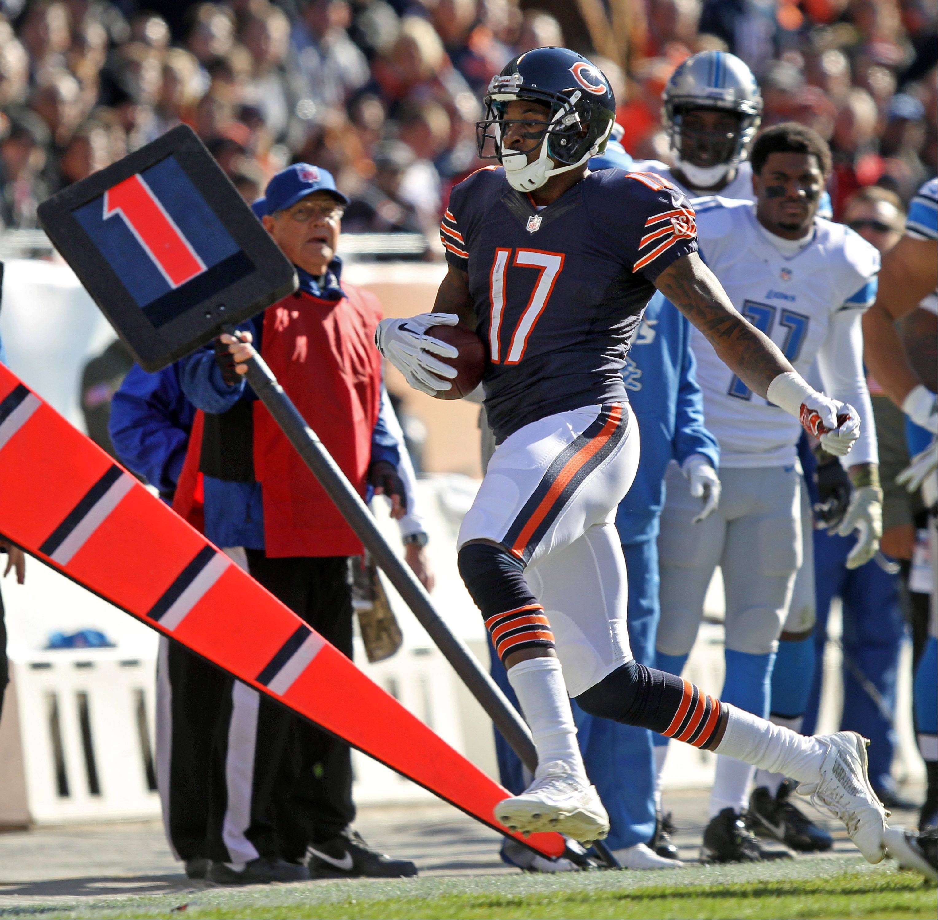 Schwind gets out of the way as Chicago Bears wide receiver Alshon Jeffery scampers out of bounds during the game.