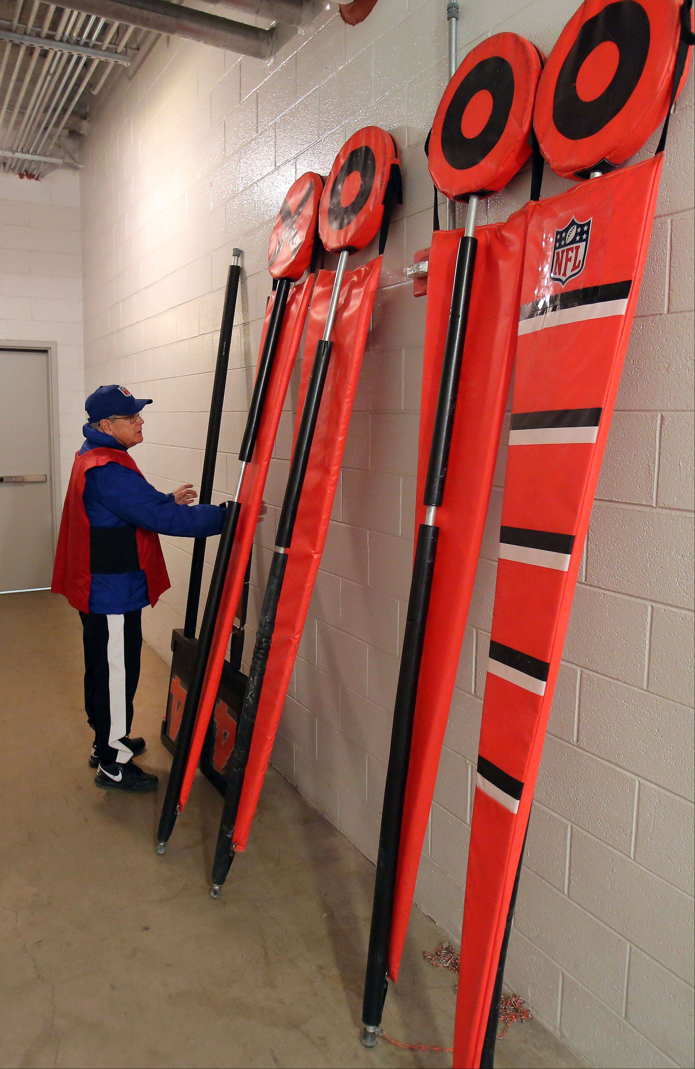 Schwind checks out the equipment prior to the Bears game Sunday, Nov. 9.