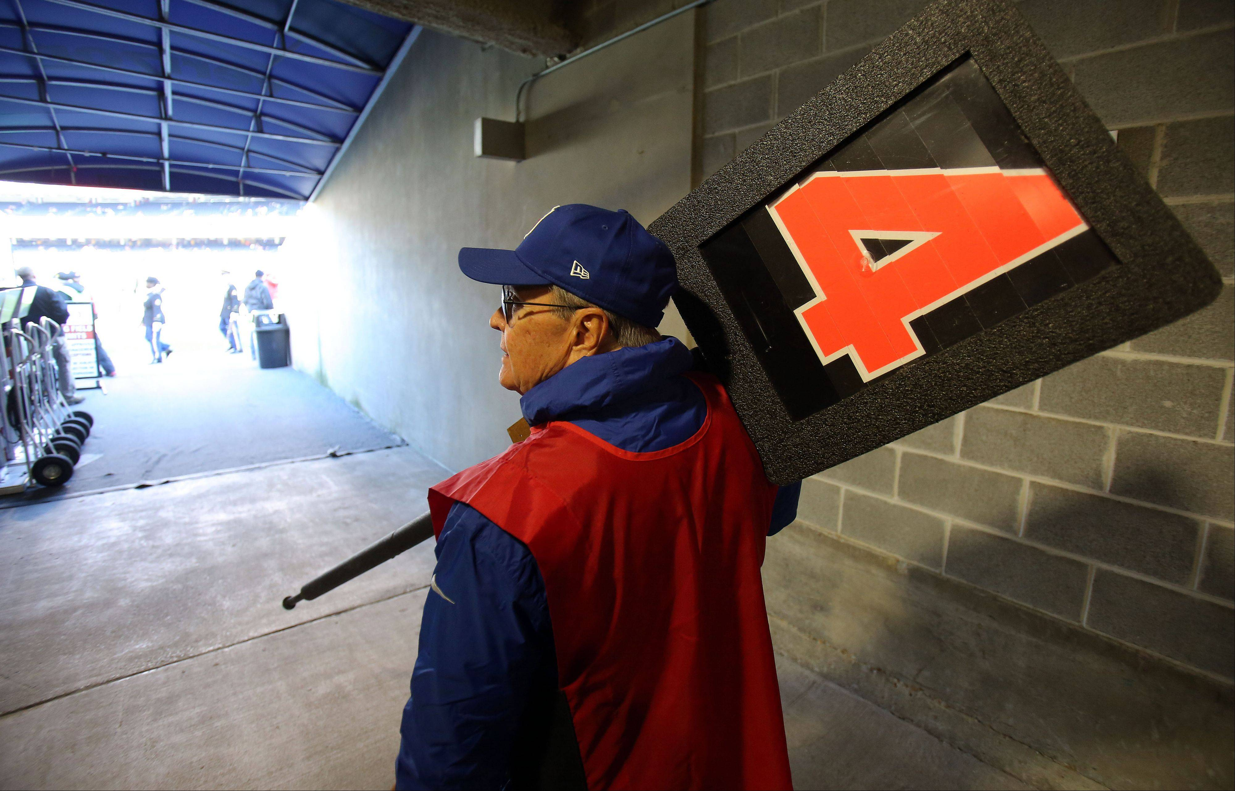 Harold Schwind of Roselle makes his way out to the field with his down marker for the Bears game Sunday, Nov. 9.