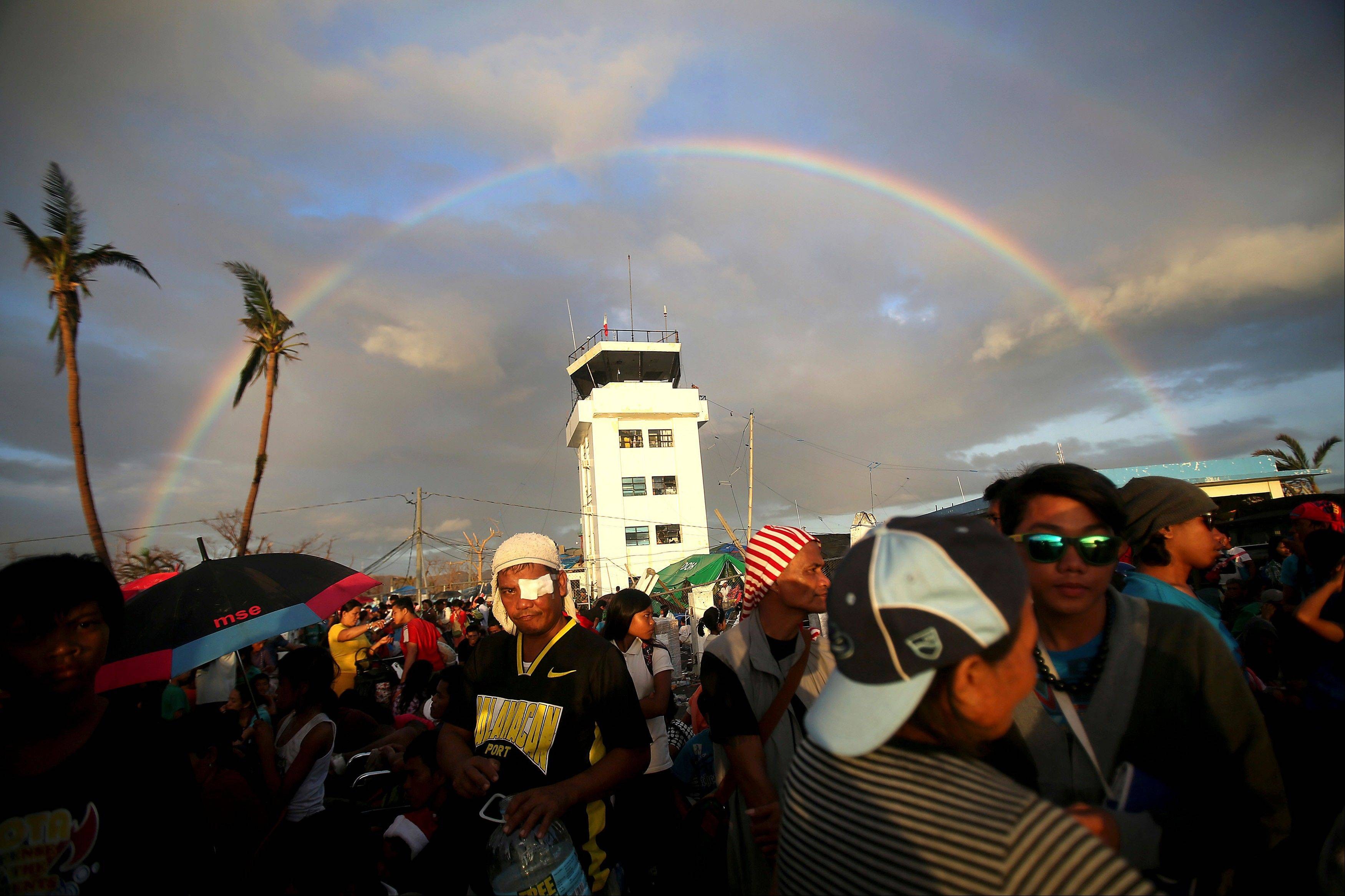 A rainbow forms over the airport in Tacloban, Leyte province, central Philippines where survivors of Typhoon Haiyan wait to be evacuated early Friday, Nov. 15, 2013. Hundreds of thousands of people were displaced by Typhoon Haiyan, which tore across several islands in the eastern Philippines on Nov. 8.