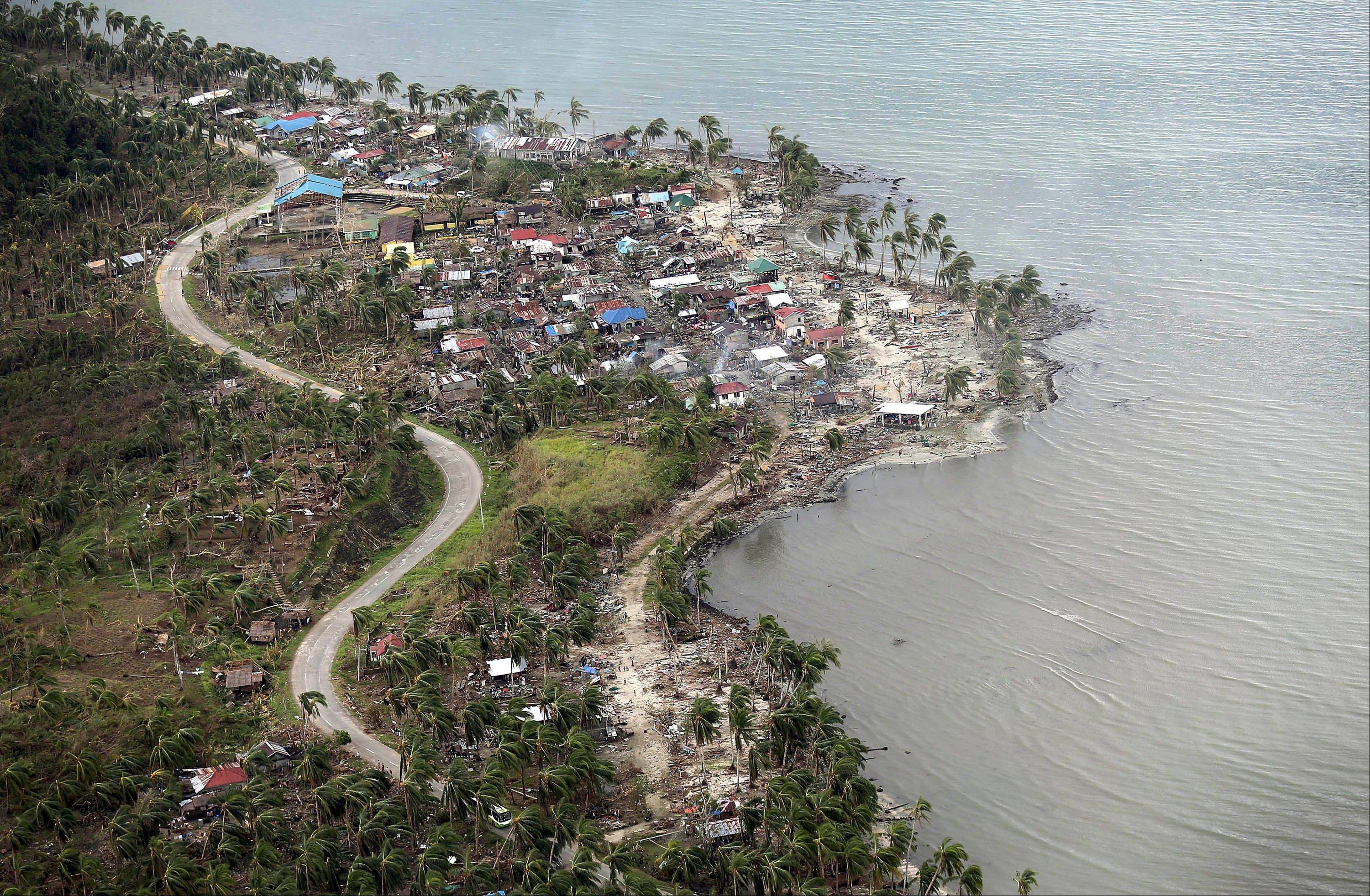 An aerial view shows the coast affected by Typhoon Haiyan Thursday, Nov. 14, 2013 in Hernani, eastern Samar, central Philippines. Typhoon Haiyan, one of the strongest storms on record, slammed into 6 central Philippine islands on Friday leaving a wide swath of destruction and thousands of people displaced.