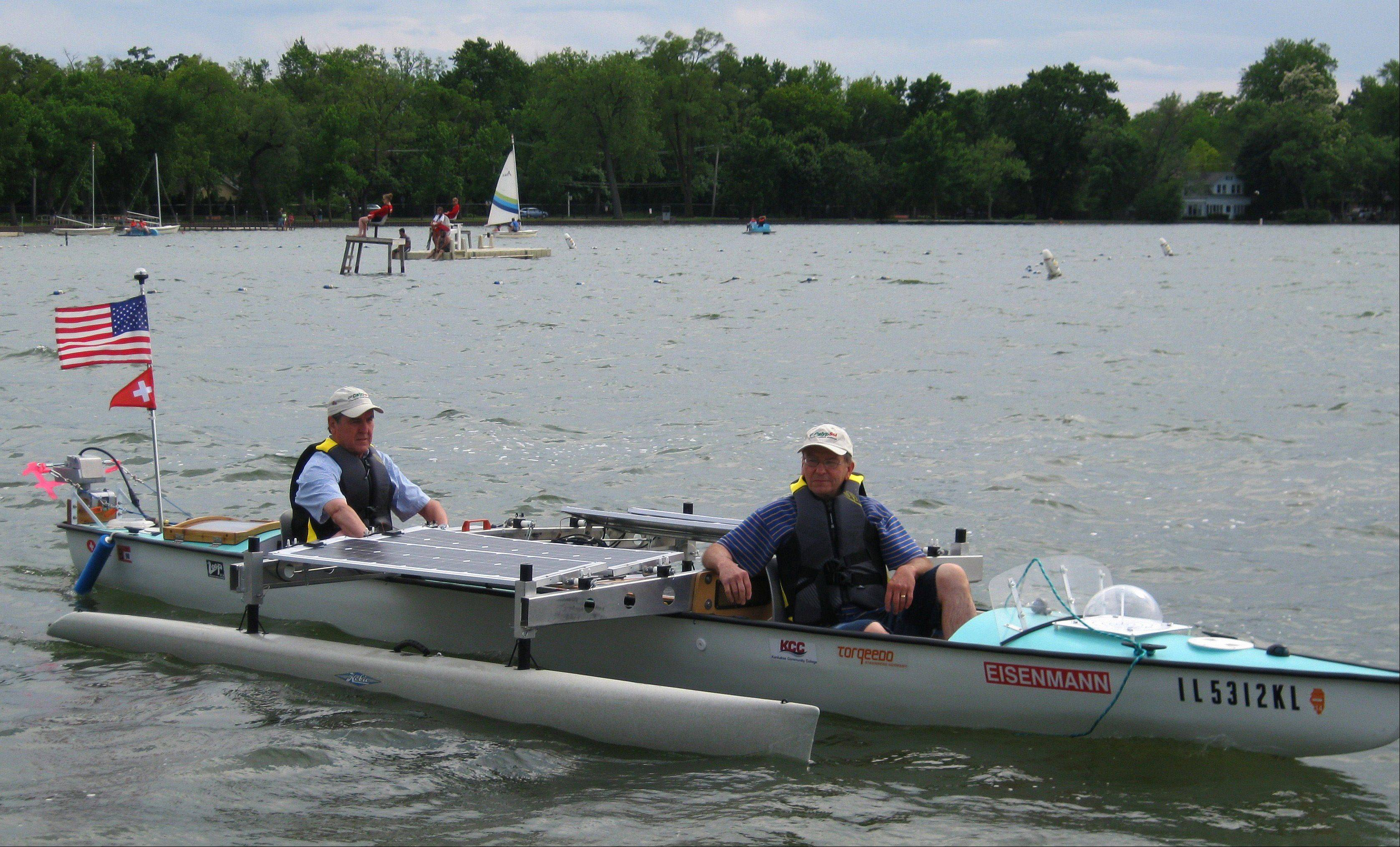 Raymond Christe of Crystal Lake, left, and Larry Kozak of Algonquin make the inaugural ride on their CalypSol Trimaran on the lake of Crystal Lake.