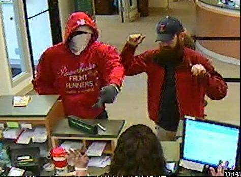 The robbery suspect, left, approaches a teller and is caught on security video Thursday at the Community Trust Credit Union in Gurnee.