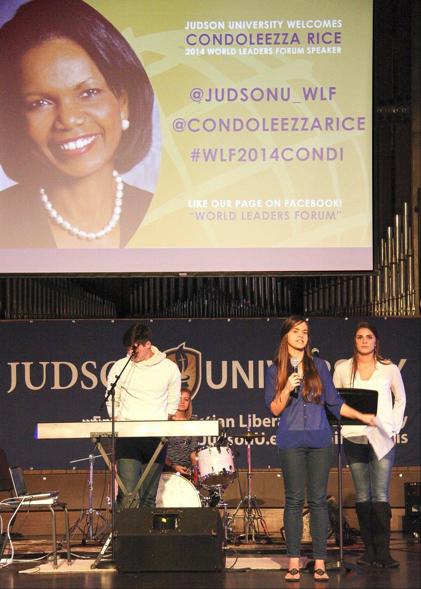 Judson University senior Cassie Criminger announces the 2014 World Leaders Forum keynote speaker, Condoleezza Rice, to hundreds of excited students, faculty and staff Friday in Elgin.