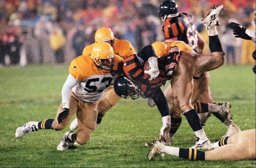 The Bears' Raymont Harris fights for yardage against the Packers in the Oct. 31, 1994, home game that featured both teams in throwback uniforms.
