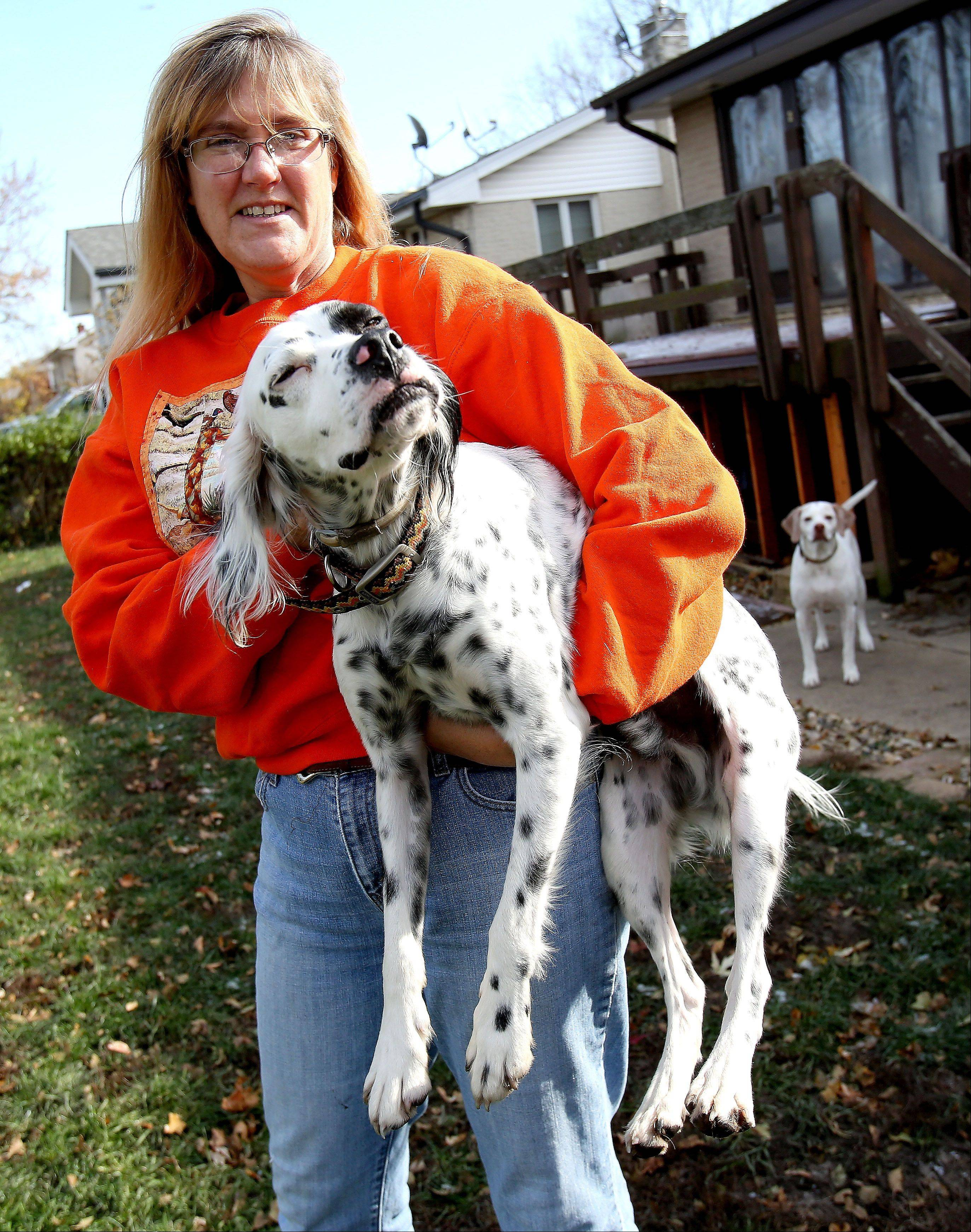 Lisa Spakowski of Wood Dale holds Gavin DaPaw, one of her five dogs that has medical issues.