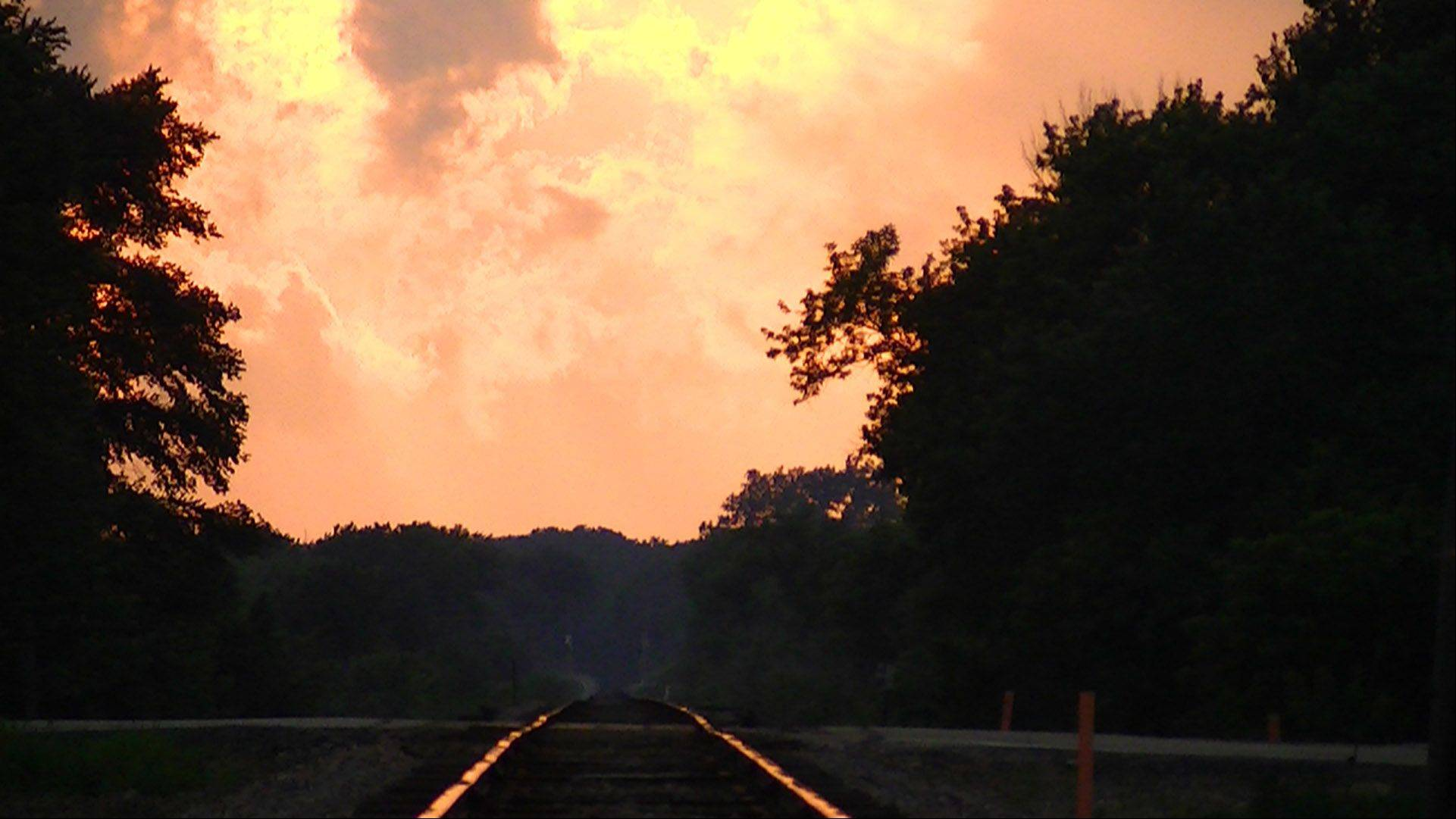 This photo was taken in Plato Center of the CN railroad tracks at sunset, looking west at a resplendent sunrise.