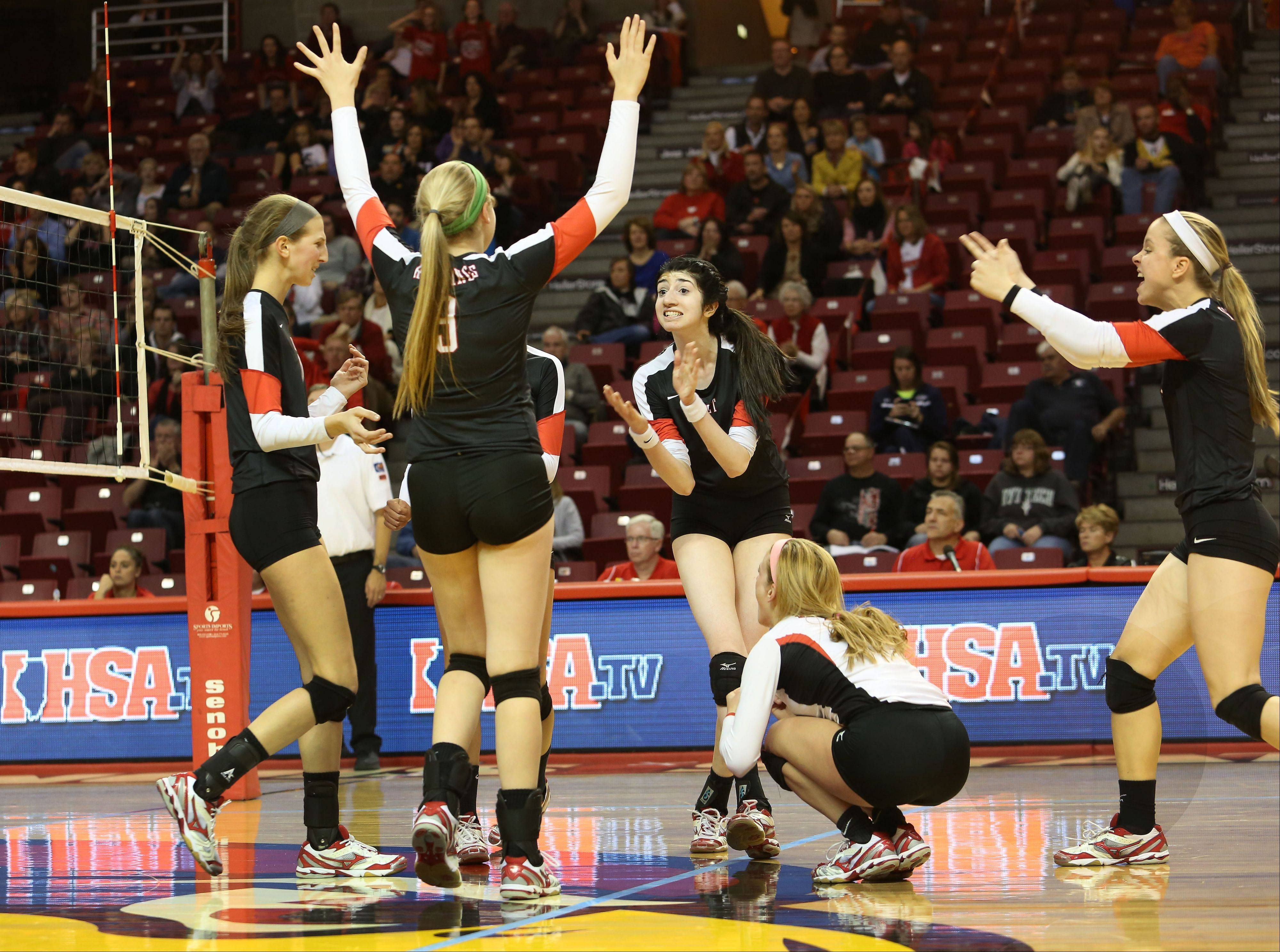 Benet reacts to a point won in its win over Crystal Lake South in Class 4A state girls volleyball action on Friday in Normal.