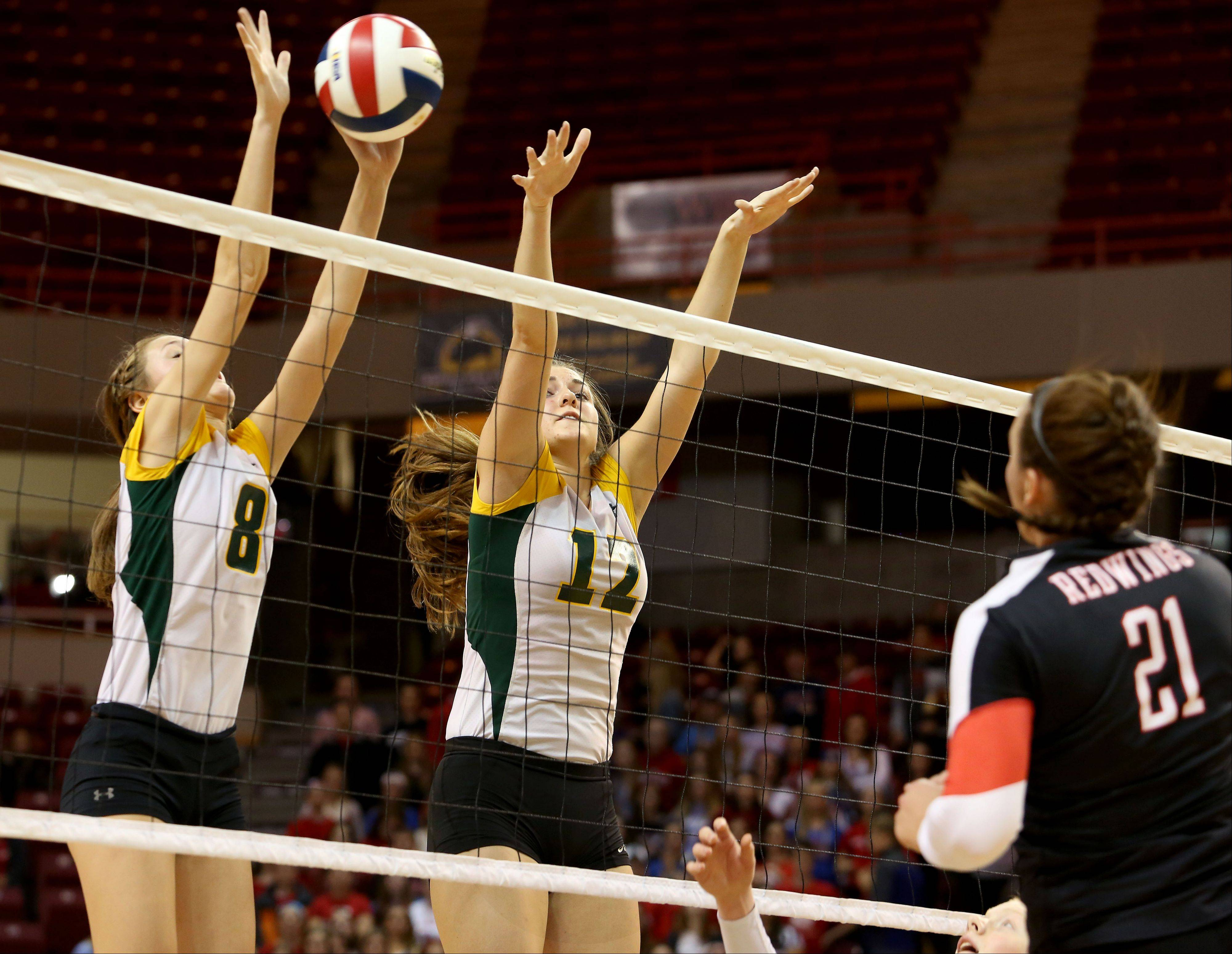 Cassy Sivesind, left and Nicole Slimko of Crystal Lake South go up to block a shot from Benet in Class 4A state girls volleyball action on Friday in Normal.