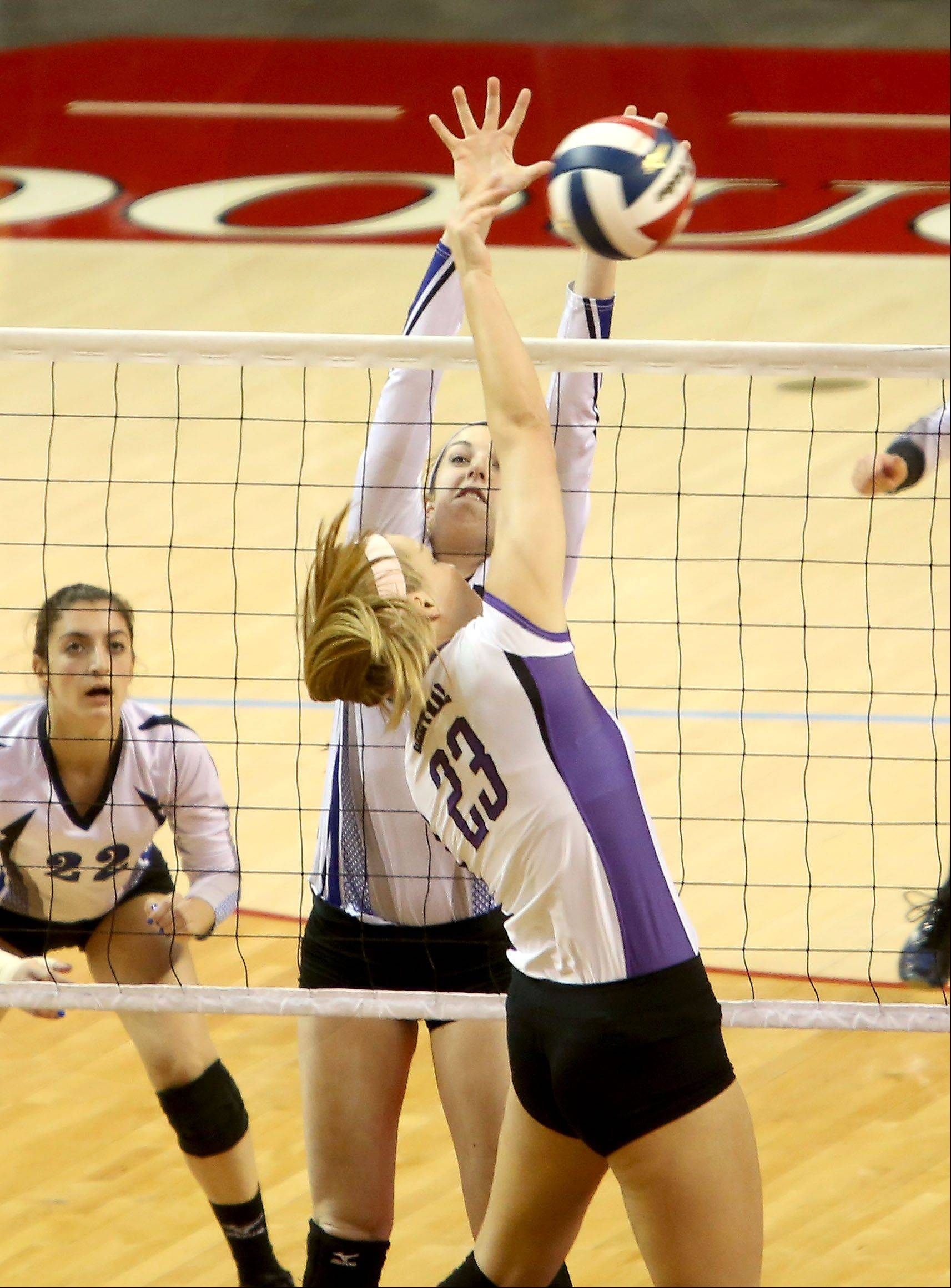 Laney Malloy of St. Francis goes up to block a shot from Madison Timmermann of Breese Central.