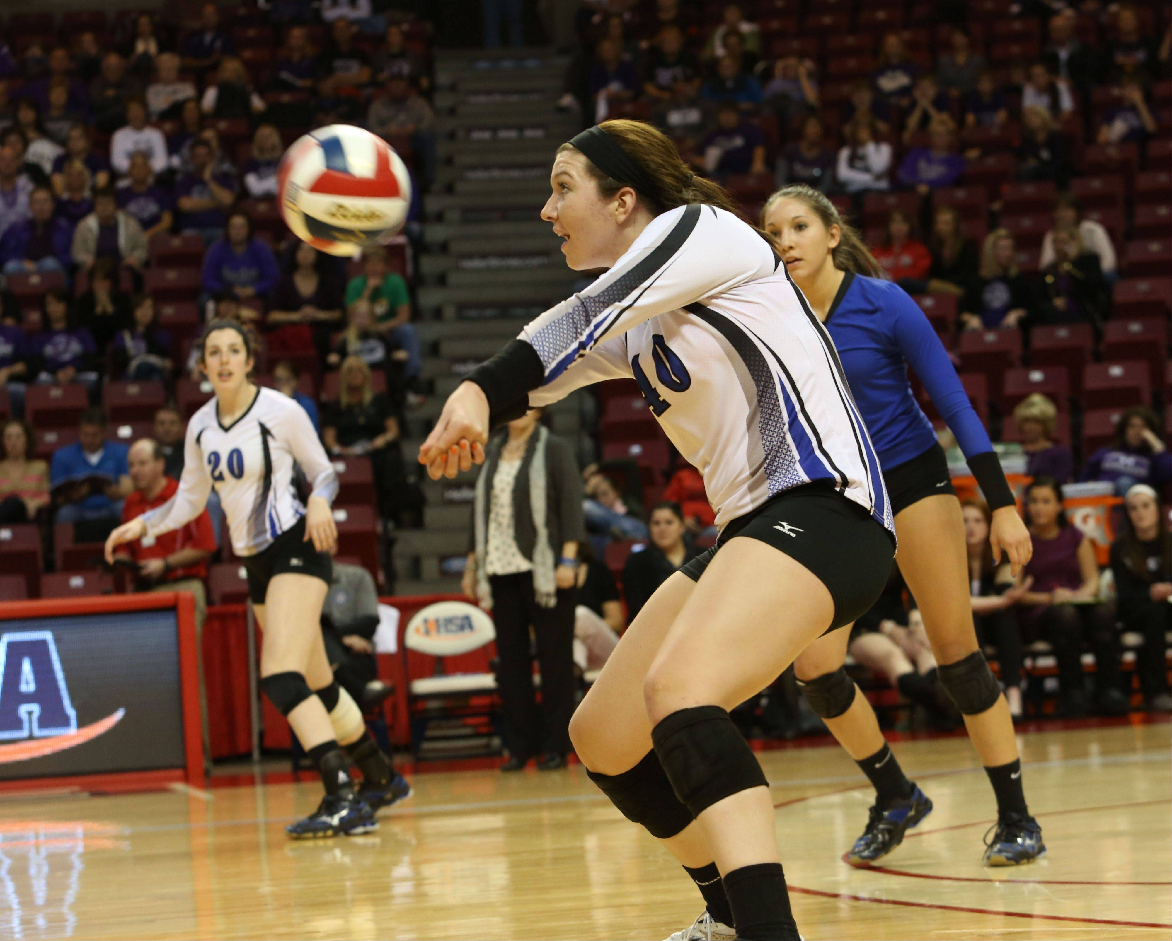 Molly Haggerty of St. Francis returns a serve.