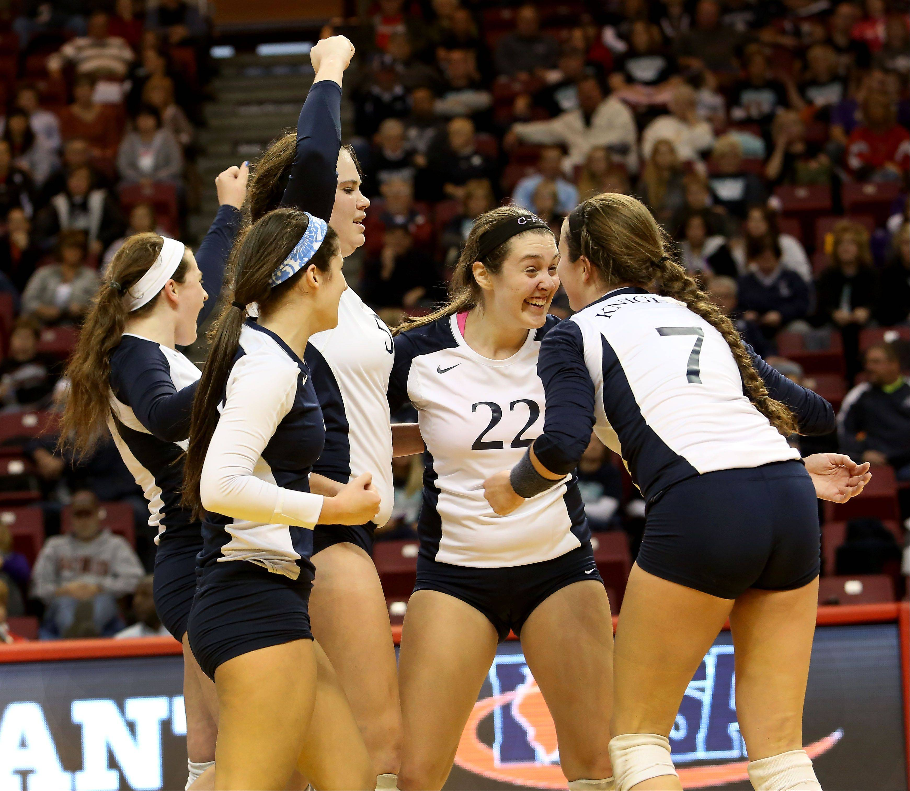IC Catholic Prep celebrates its win over Deer Creek-Mackinaw in Class 2A state semifinal girls volleyball on Friday in Normal.