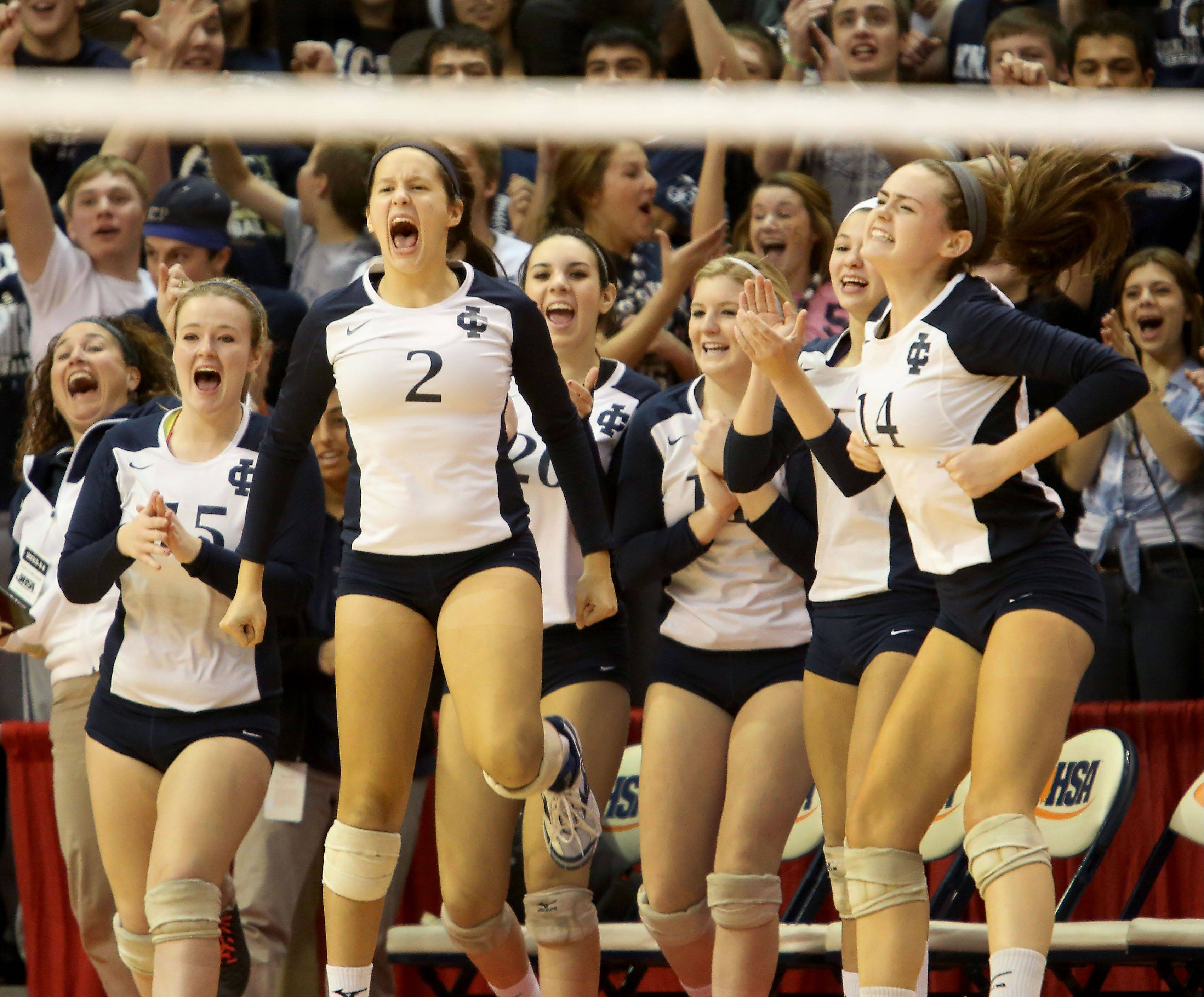 The IC Catholic Prep bench reacts to the first-set win over Deer Creek-Mackinaw in Class 2A state girls volleyball semifinal action on Friday in Normal.