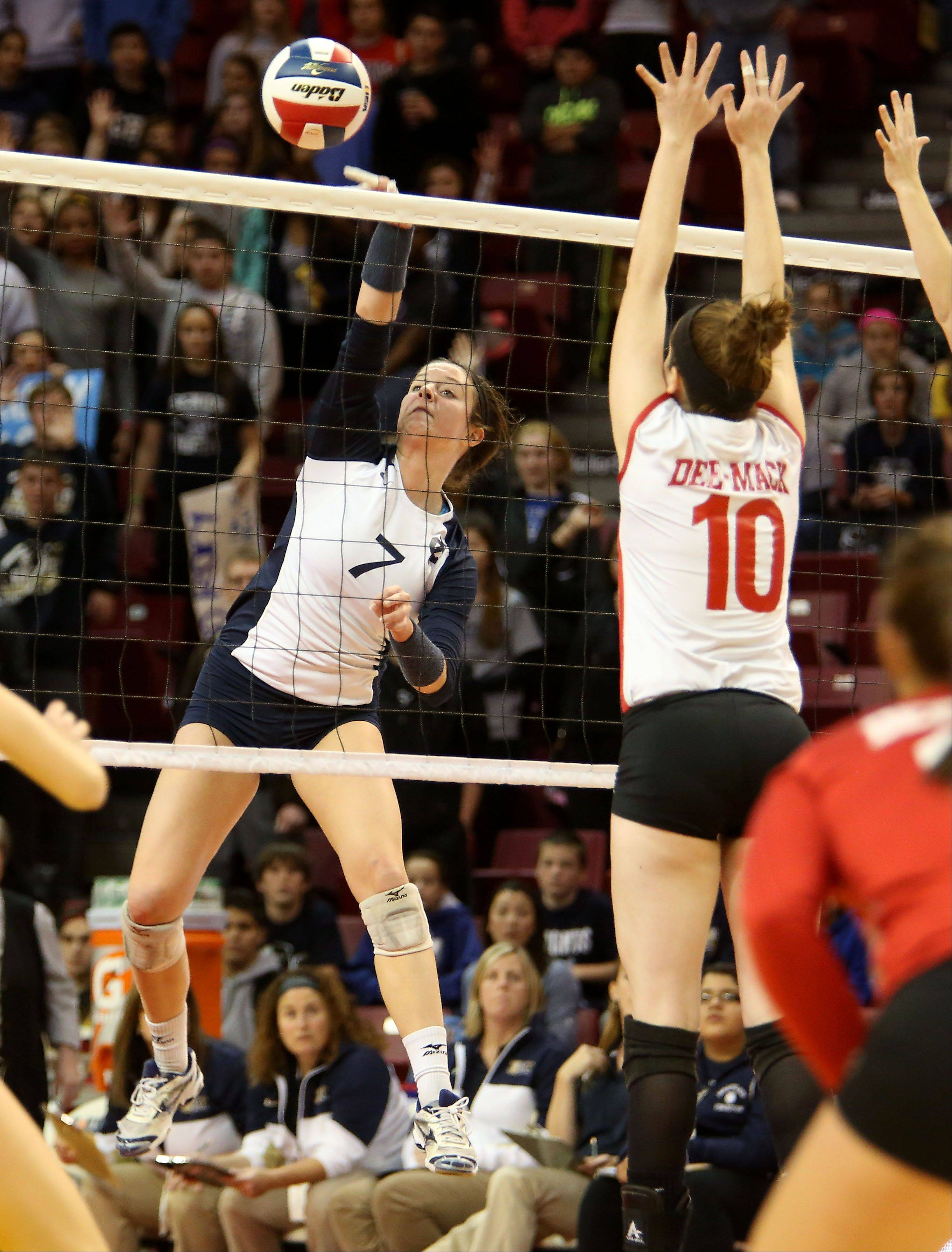 Delaney D'Amore of IC Catholic Prep spikes the ball to Deer Creek-Mackinaw in Class 2A state girls volleyball action on Friday in Normal.