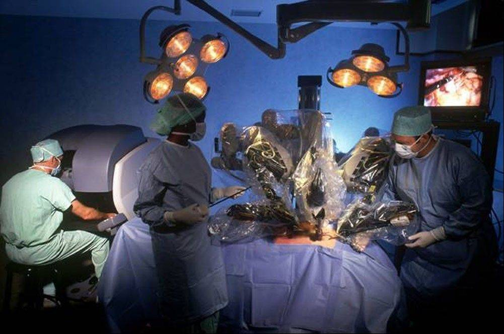 Robotic surgeries are on the rise, fueled by aggressive marketing that has hyped the procedure, often claimed fewer complications without proof, and sometimes ignored contradictory studies finding no advantage. Surgeons practice using a robotic surgical system in this handout photo from its maker, Intuitive Surgical, Inc.