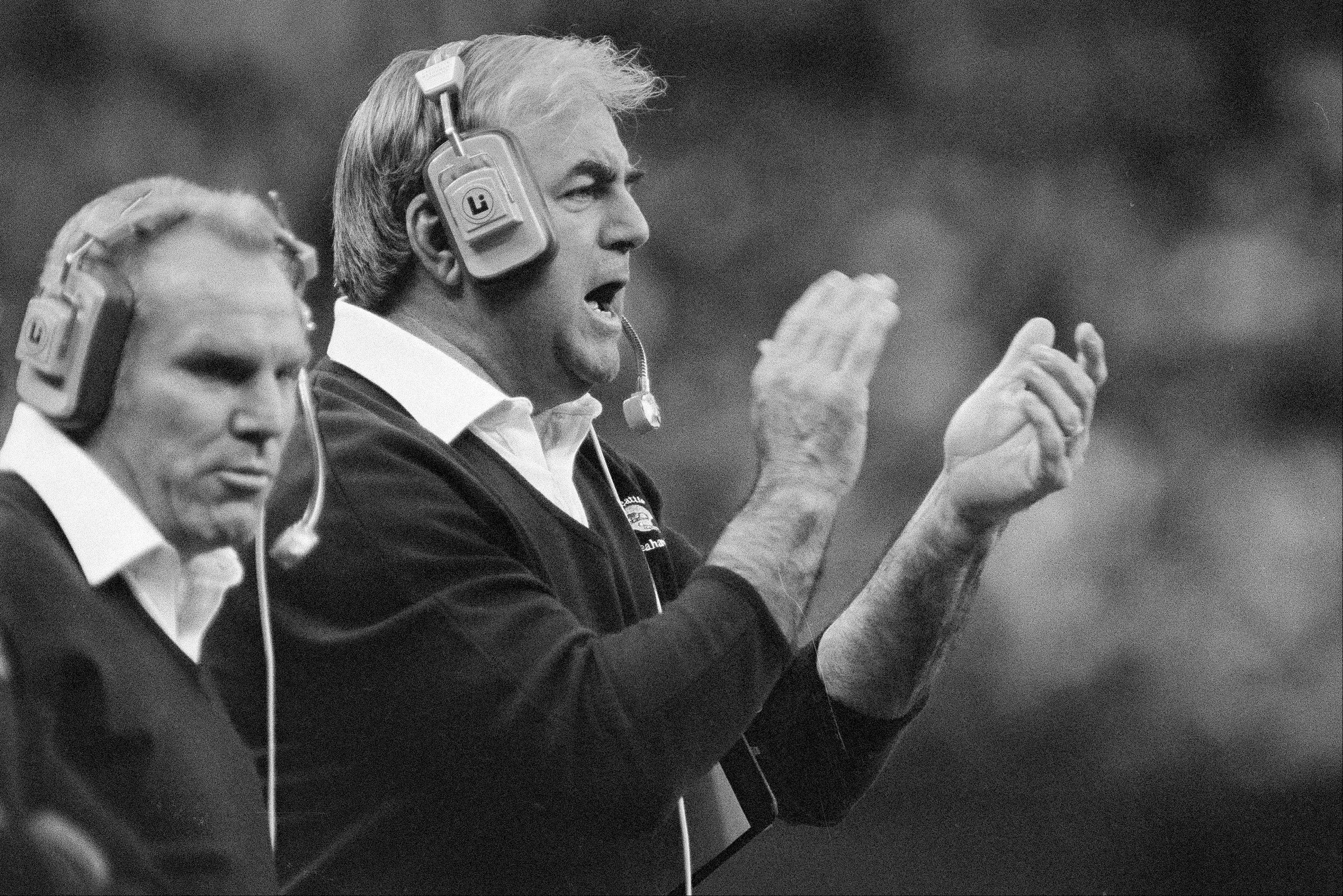 Seattle Seahawks head coach Mike McCormack claps his hands while shouting encouragement to his players during an NFL football game against the Chicago Bears in the Kingdome in Seattle.