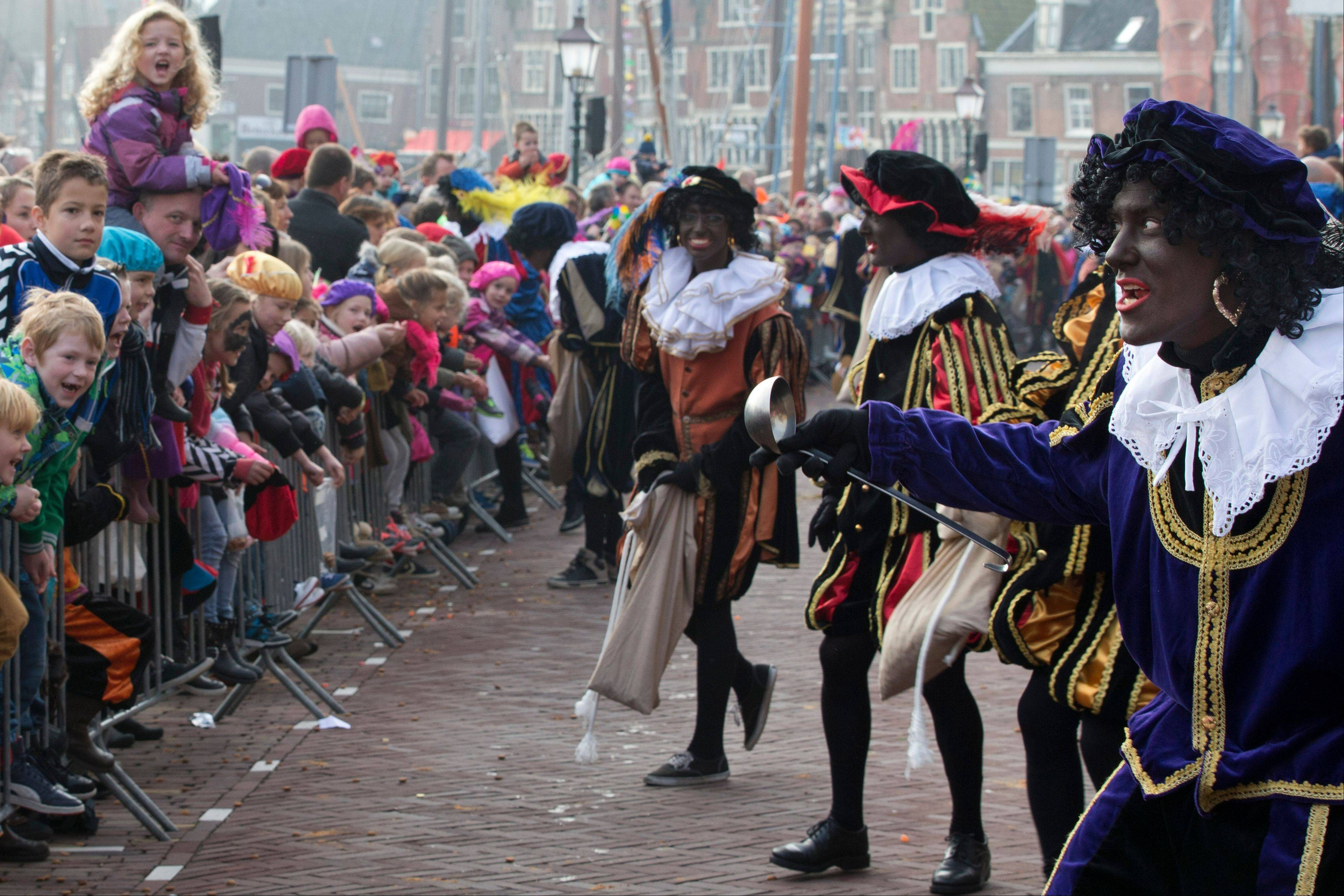 The Dutch version of Santa Claus, Sinterklaas, or Saint Nicholas, and his blackface sidekicks �Zwarte Piet� or �Black Pete� arrive by steamboat Saturday in Hoorn, north-western Netherlands.
