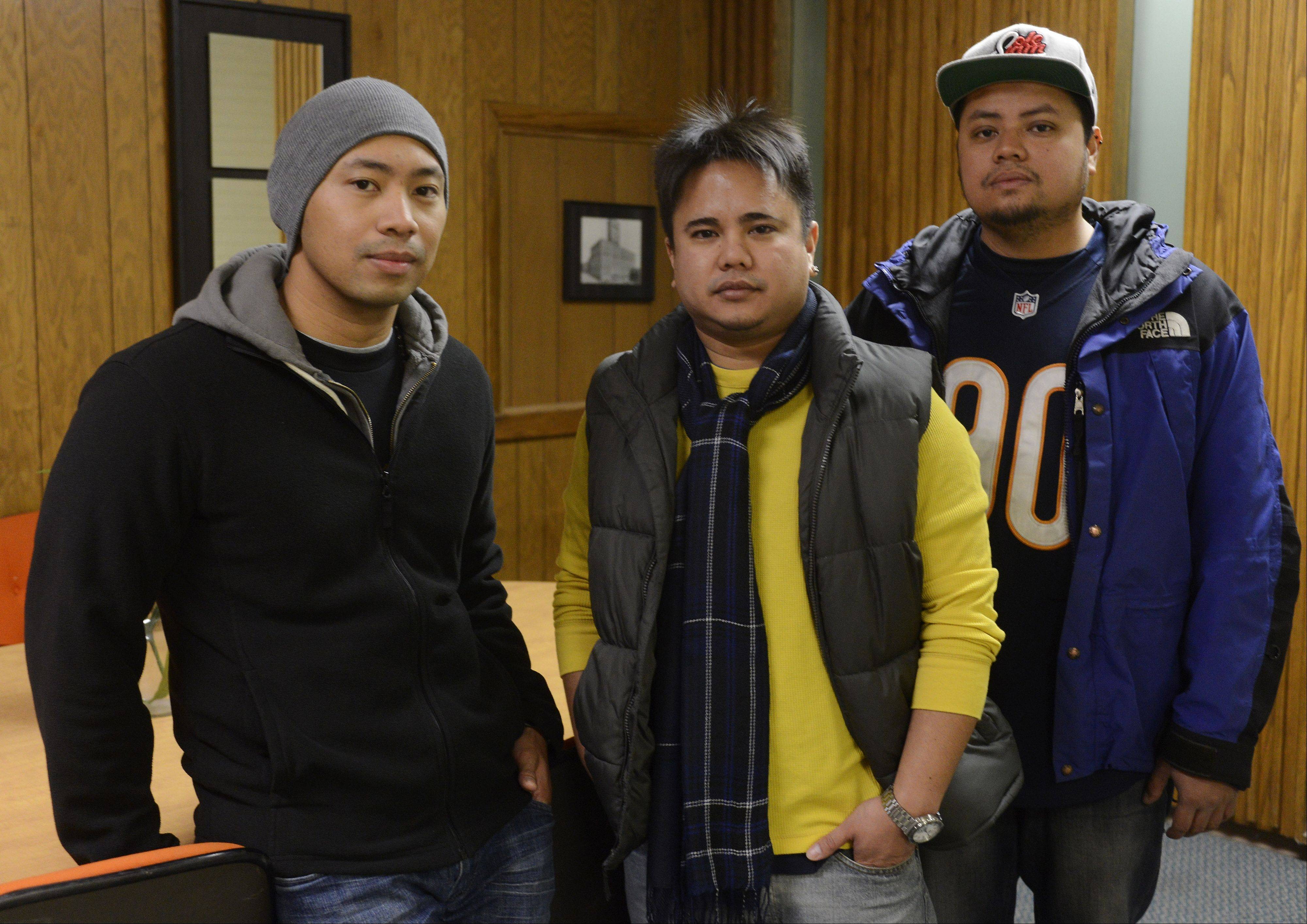 Dante Parado, left, with the help of friends Jorel Santos, middle, and Justin Fernandez, has organized a fundraising walk/run that will benefit the relief efforts going on in the Philippines in the aftermath of Typhoon Haiyan.