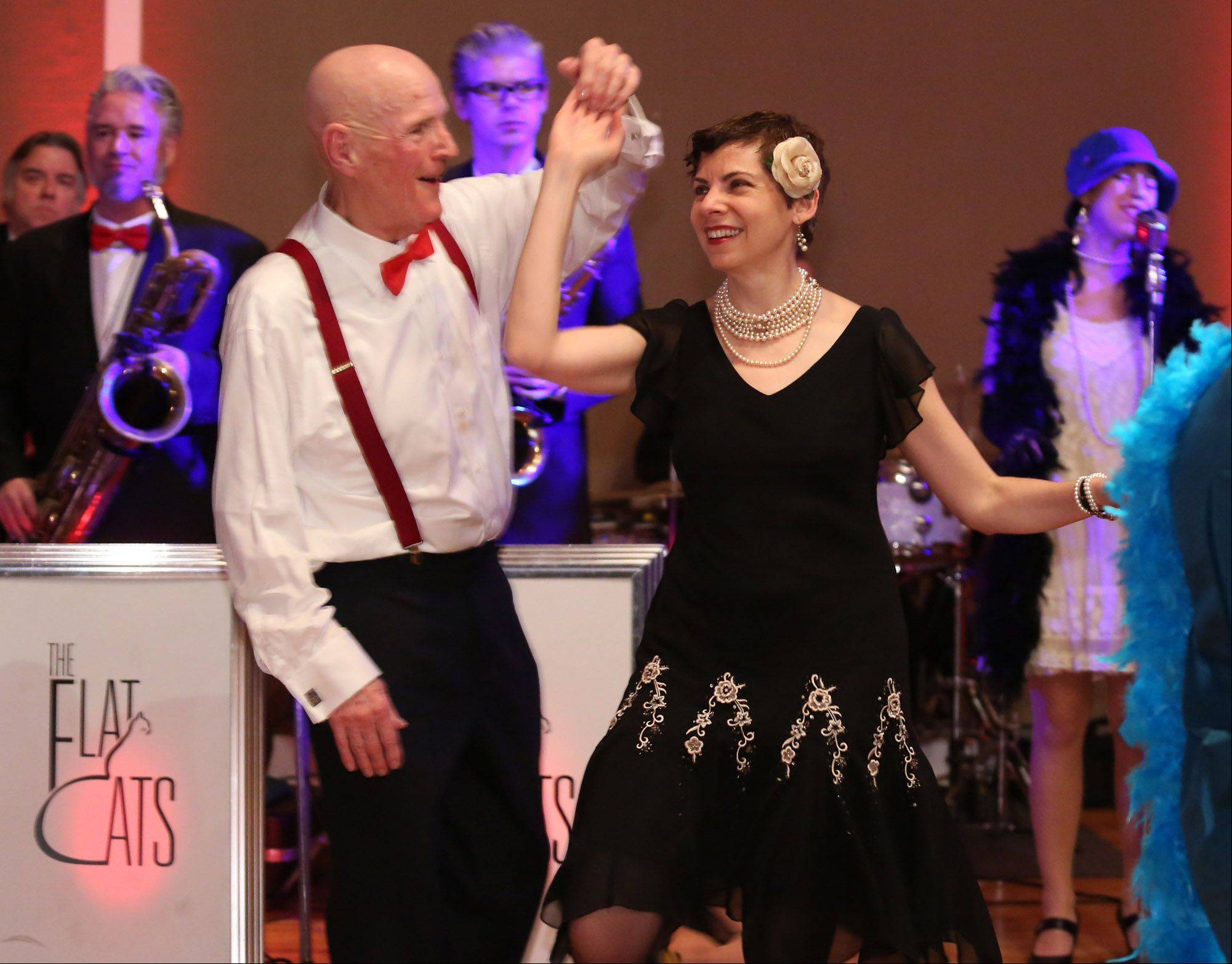 "George LeClaire/gleclaire@dailyherald.com Tom Thomas of Sleepy Hollow dances with friend Mary Roback of Park Ridge at the Arlington Heights Historical Society´s Speakeasy FUNdraiser ""A Celebration of the Decades: the Roaring 1920sÓ event at the Metropolis Ballroom on Friday in Arlington Heights."