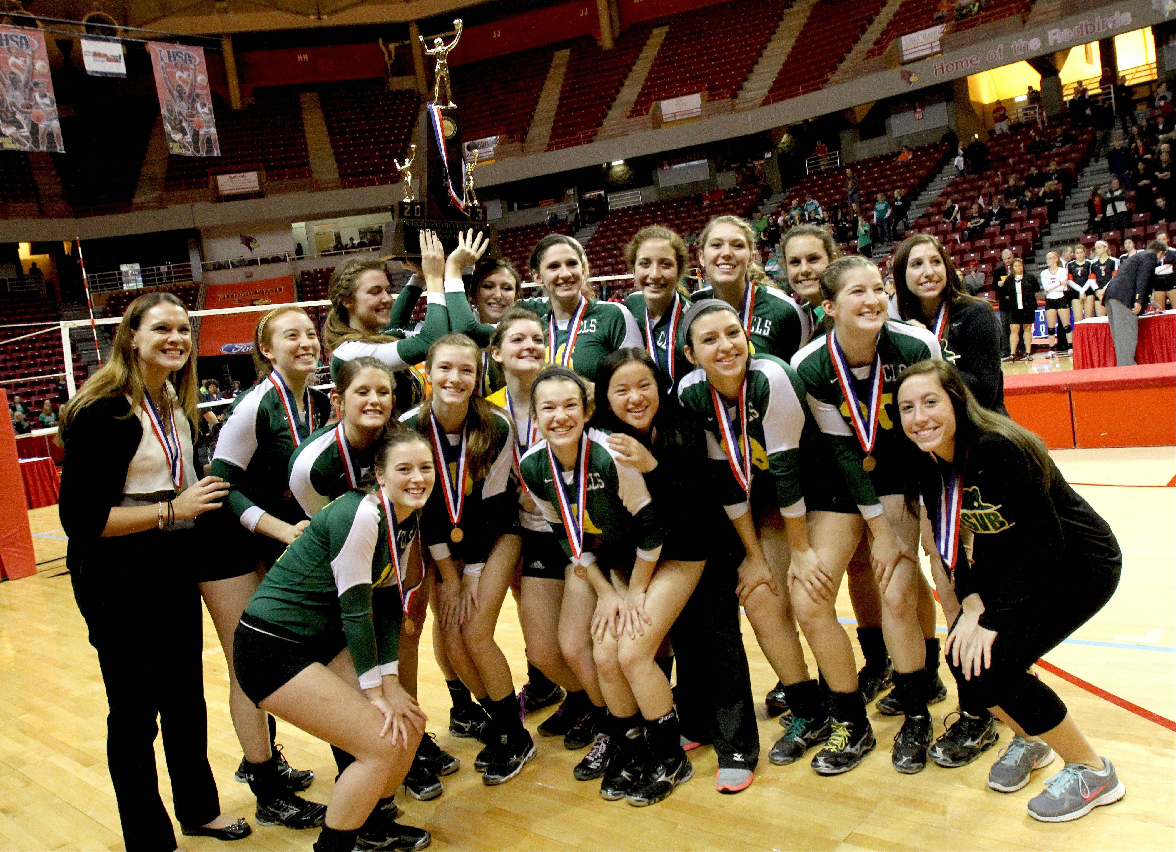 Crystal Lake South shows off its fourth place trophy in Class 4A state girls volleyball on Saturday in Normal.