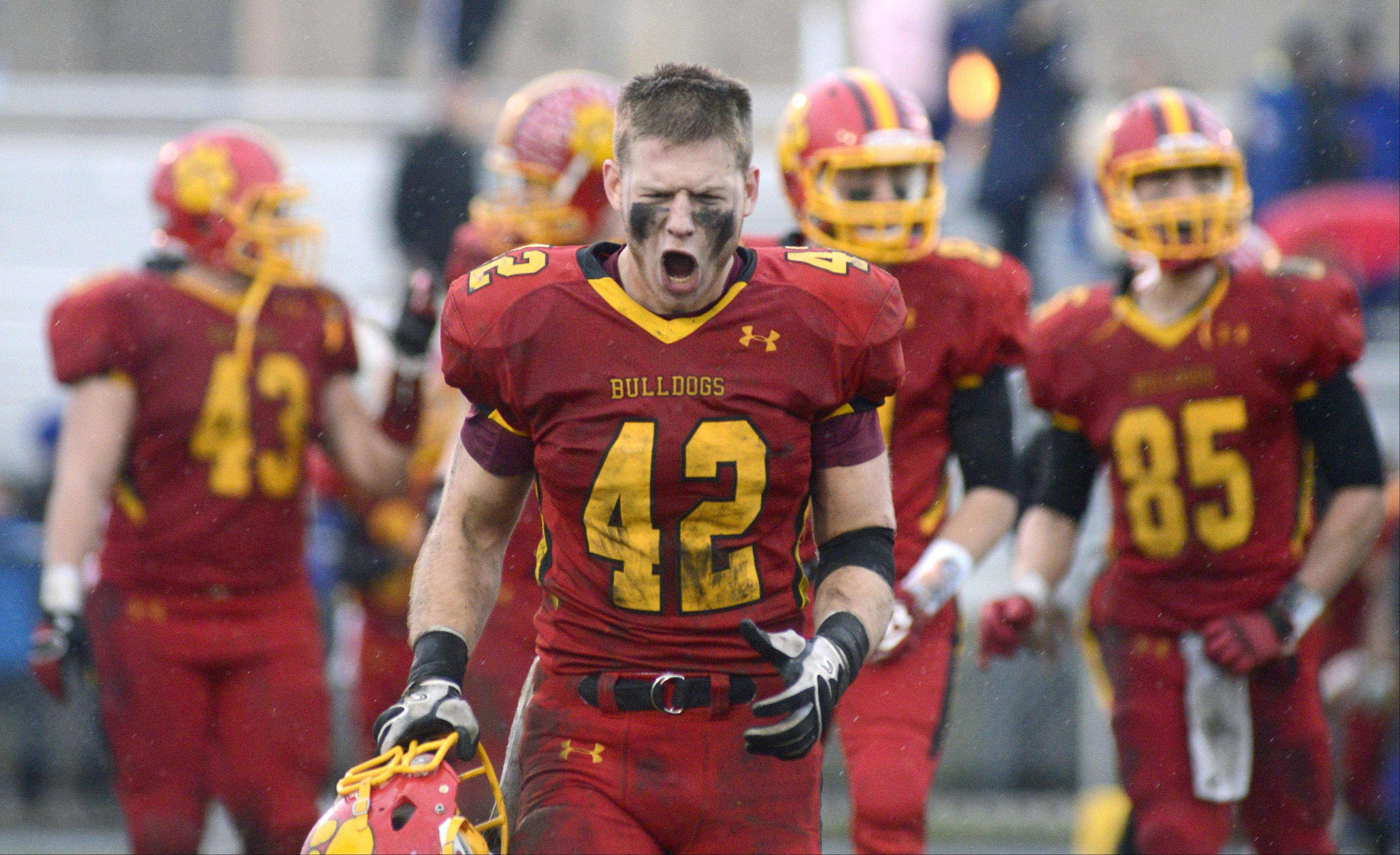 Batavia�s Rourke Mullins skips over the goal line after shaking off Lake Forest�s Andrew Nelson (6) and Jake Yale in the third quarter of the Class 6A quarterfinal on Saturday, November 16.