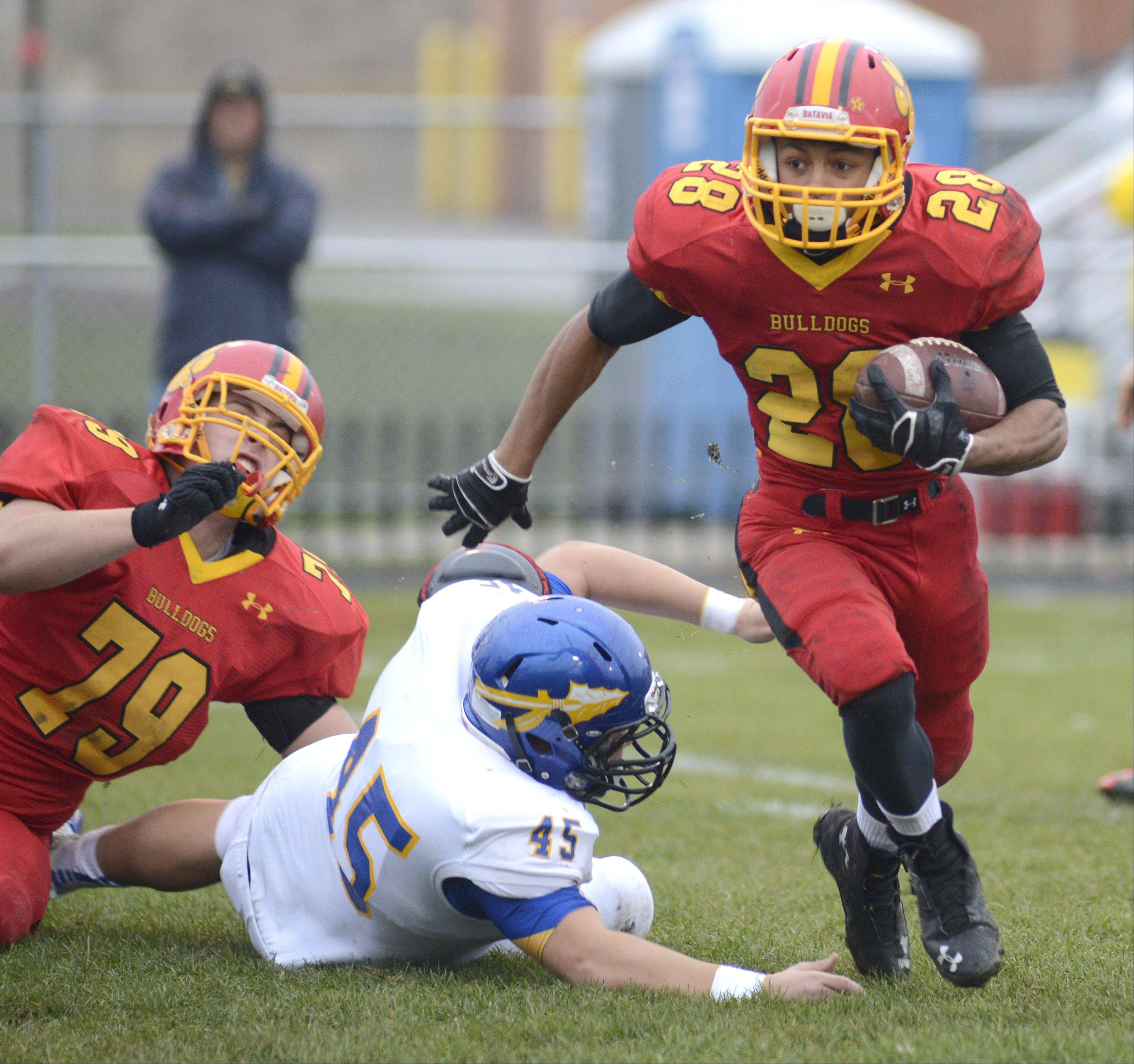 Batavia's Anthony Scaccia sprints from Lake Forest's John Cirame as teammate Max Heidgen takes him down in the first quarter of the Class 6A quarterfinal on Saturday, November 16.