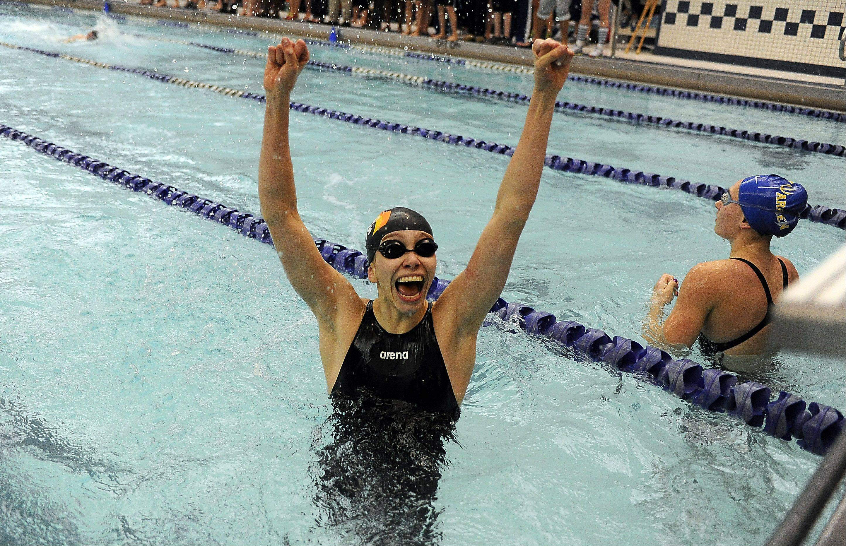 Sophia Lex of Libertyville celebrates her team�s victory in the girls 200-yard medley relay in sectional swimming at Vernon Hills High School on Saturday. Her teammates were Macey Neubauer, Staci Herchenbach and Meredith Robbins.