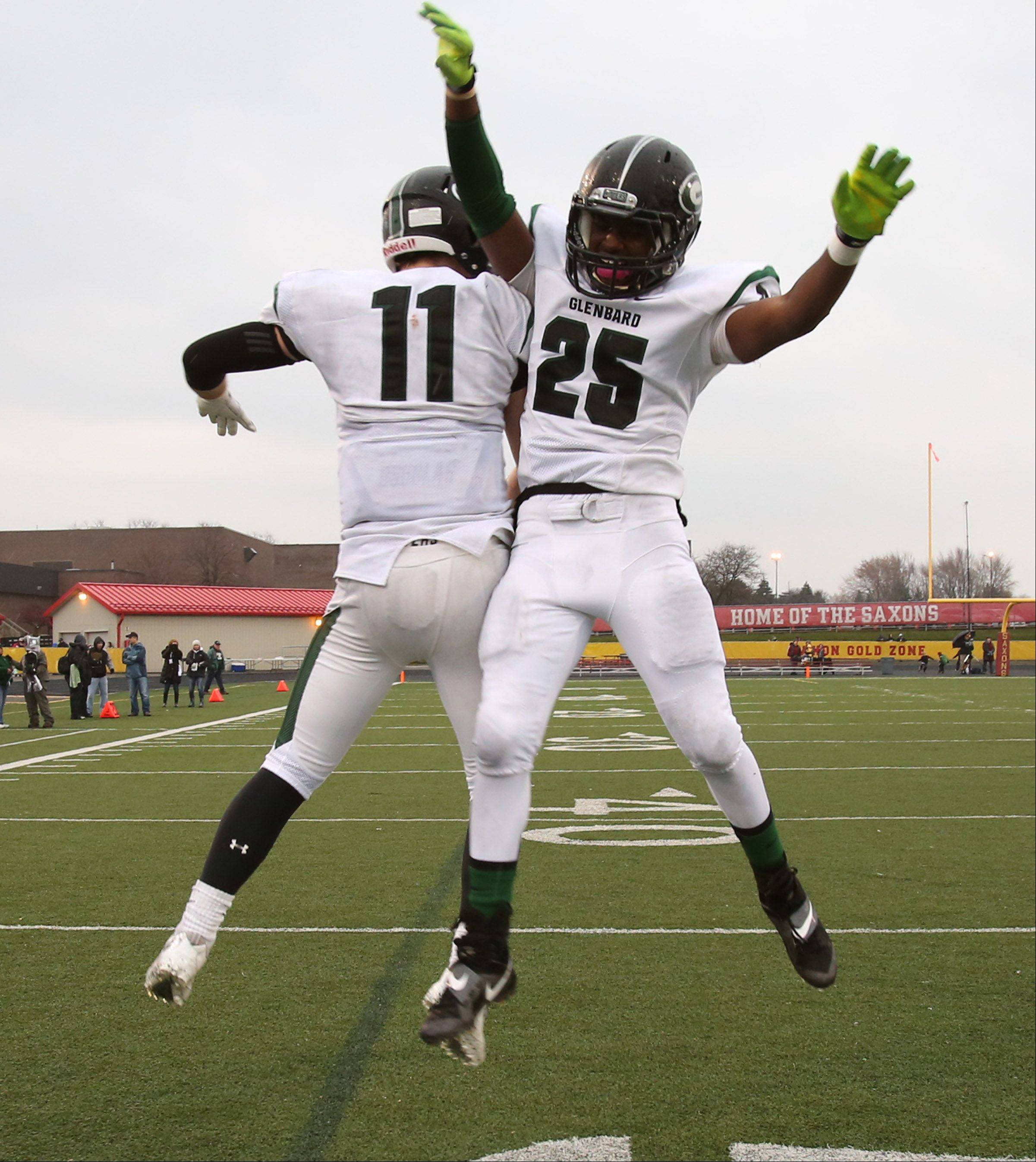 Glenbard West Grant Greeno, left, and Jordon Andrews celebrate as the clock expires as Glenbard West wins 42-21 over Schaumburg in a quarterfinal playoff game on Saturday in Schaumburg.