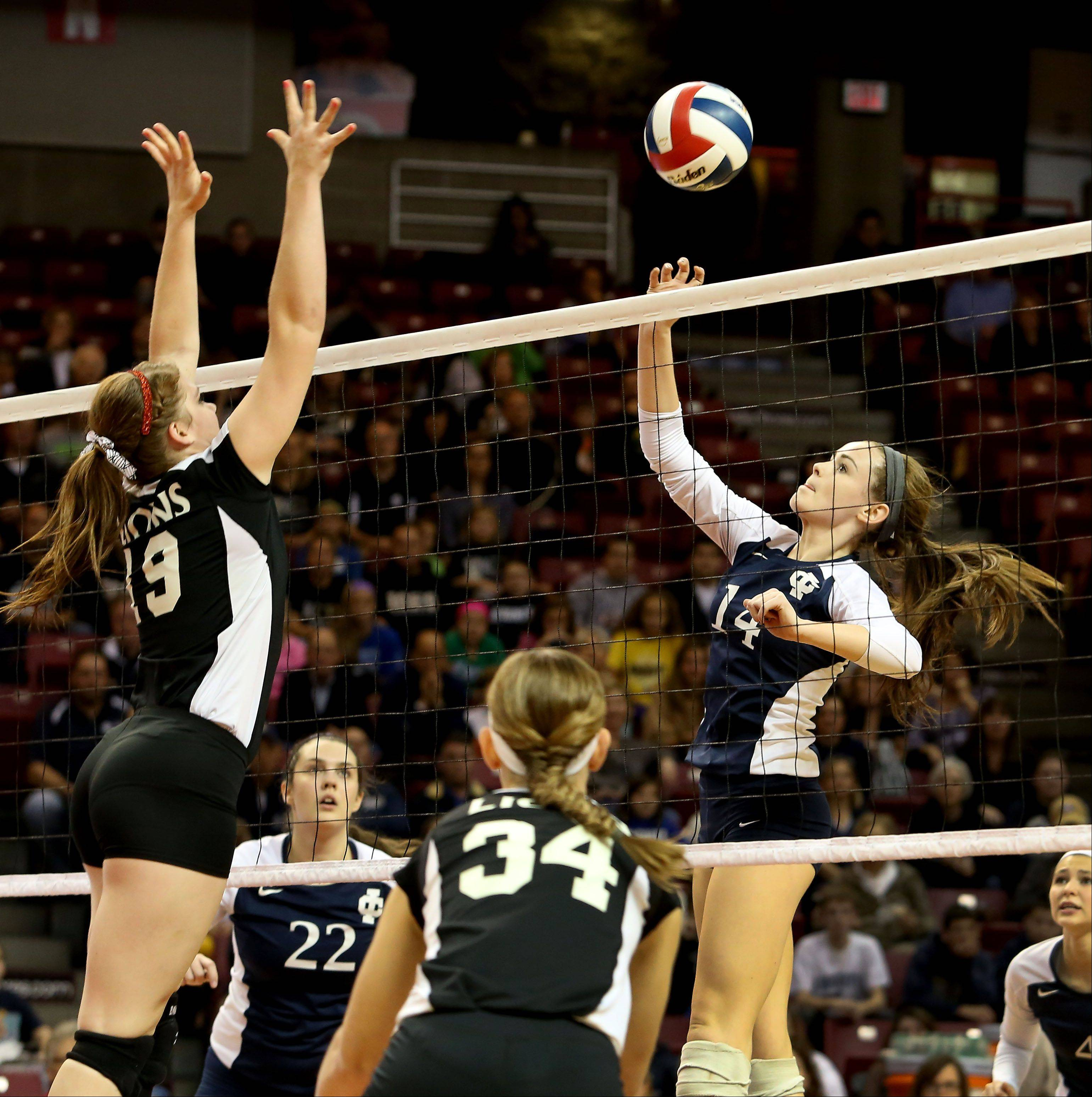 Claudia Koch of IC Catholic, right, in action against Edwards County in the Class 2A championship girls volleyball match on Saturday in Normal.