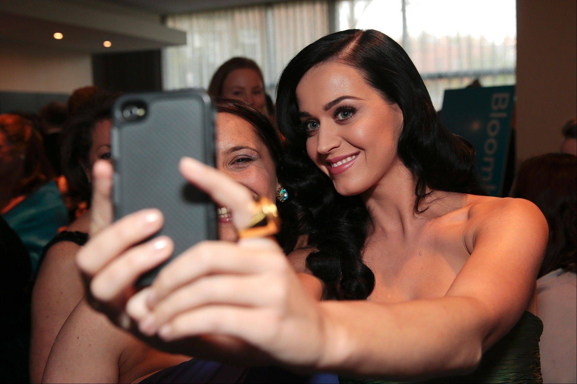 "BloombergKaty Perry, Justin Bieber and Lady Gaga are Twitter's most followed celebrities and have even more Facebook ""likes."" Amping up the rivalry between the two web upstarts, Facebook is preparing a tool that makes it easier for celebs to chat with fans, a source says. Shown, Perry takes a photo before April's White House Correspondents' Association dinner in Washington."