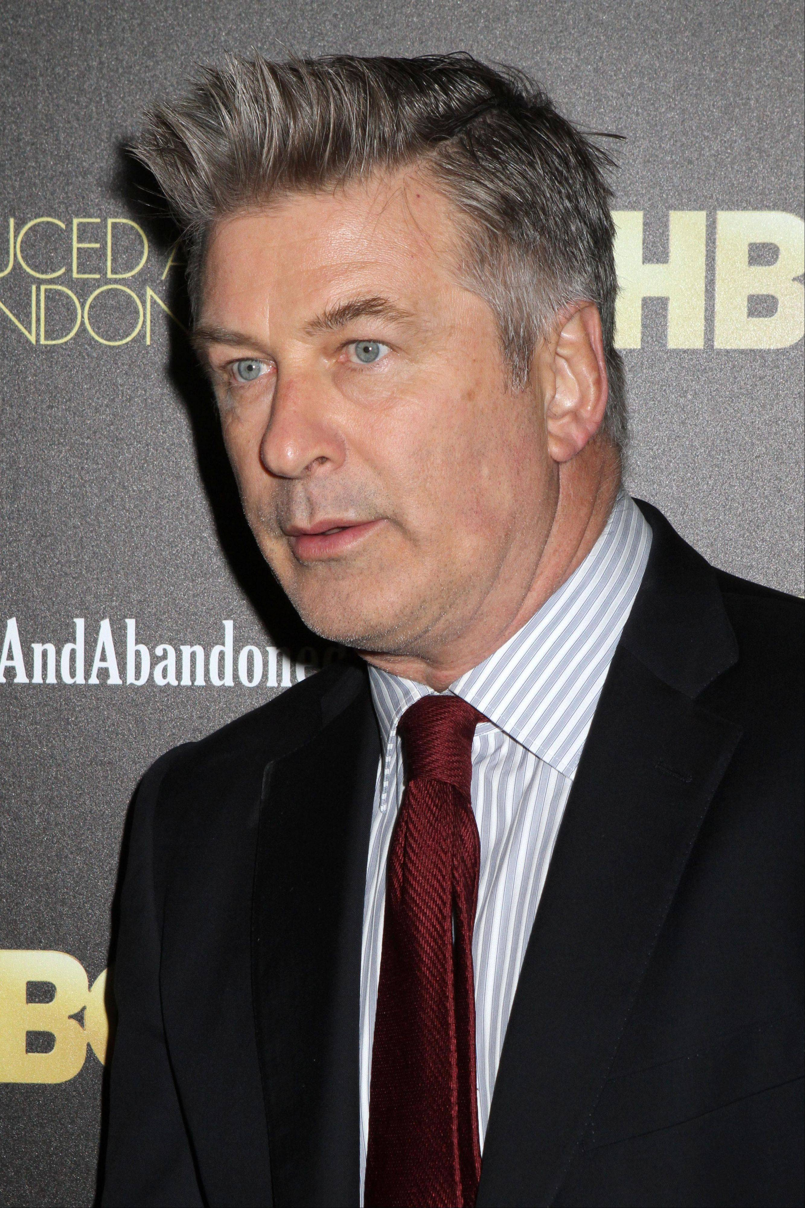 "In this Oct. 24, 2013 file photo, producer and actor Alec Baldwin attends the HBO premiere of ""Seduced and Abandoned"" at The Time Warner Center in New York. On Friday, MSNBC suspended Baldwin for two weeks for inflammatory remarks he made to a reporter earlier in the week."