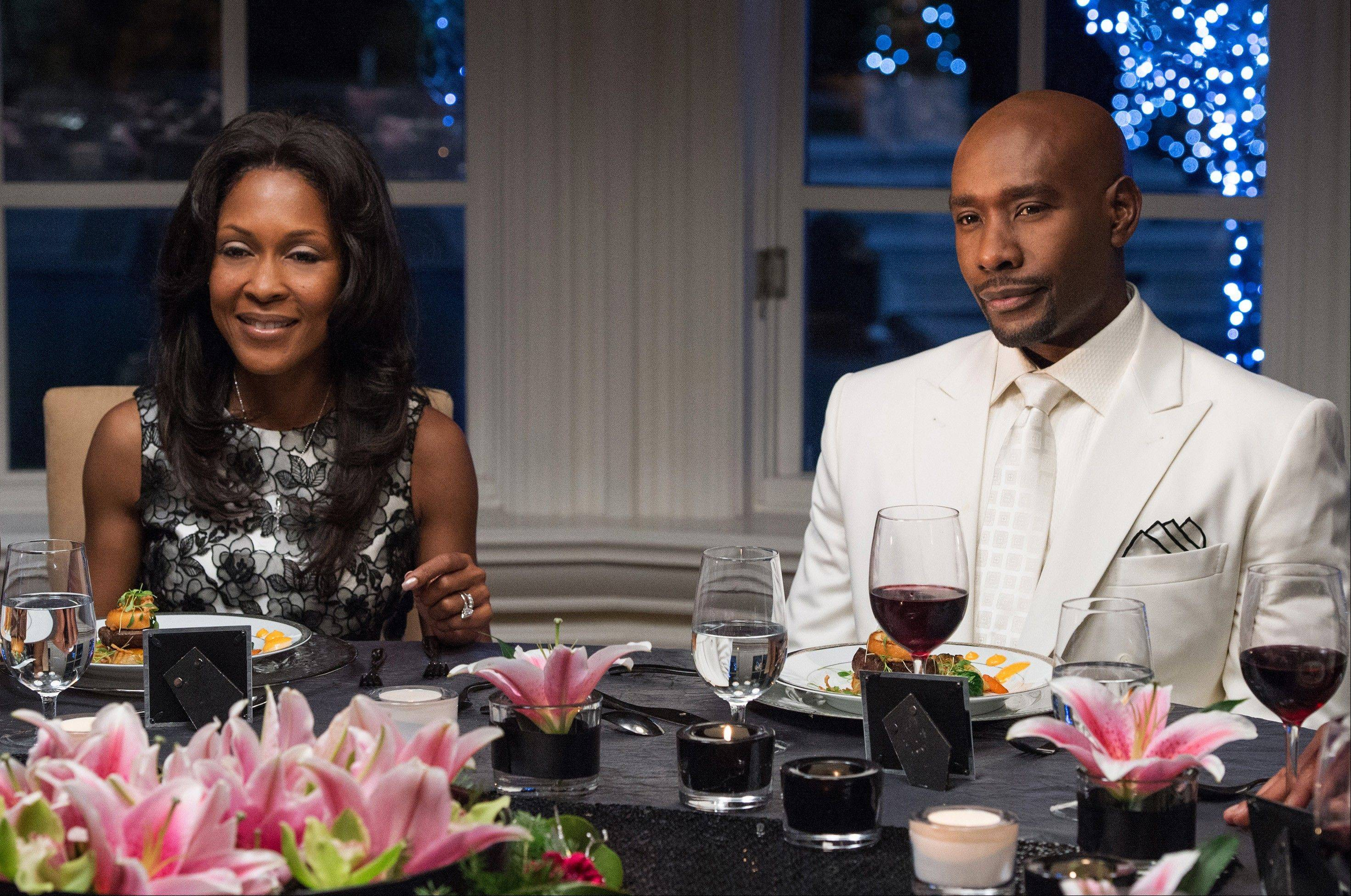 "Morris Chestnut, right, and Monica Calhoun reprise their roles as Lance and Mia in the sequel ""The Best Man Holiday,"" in theaters this weekend."