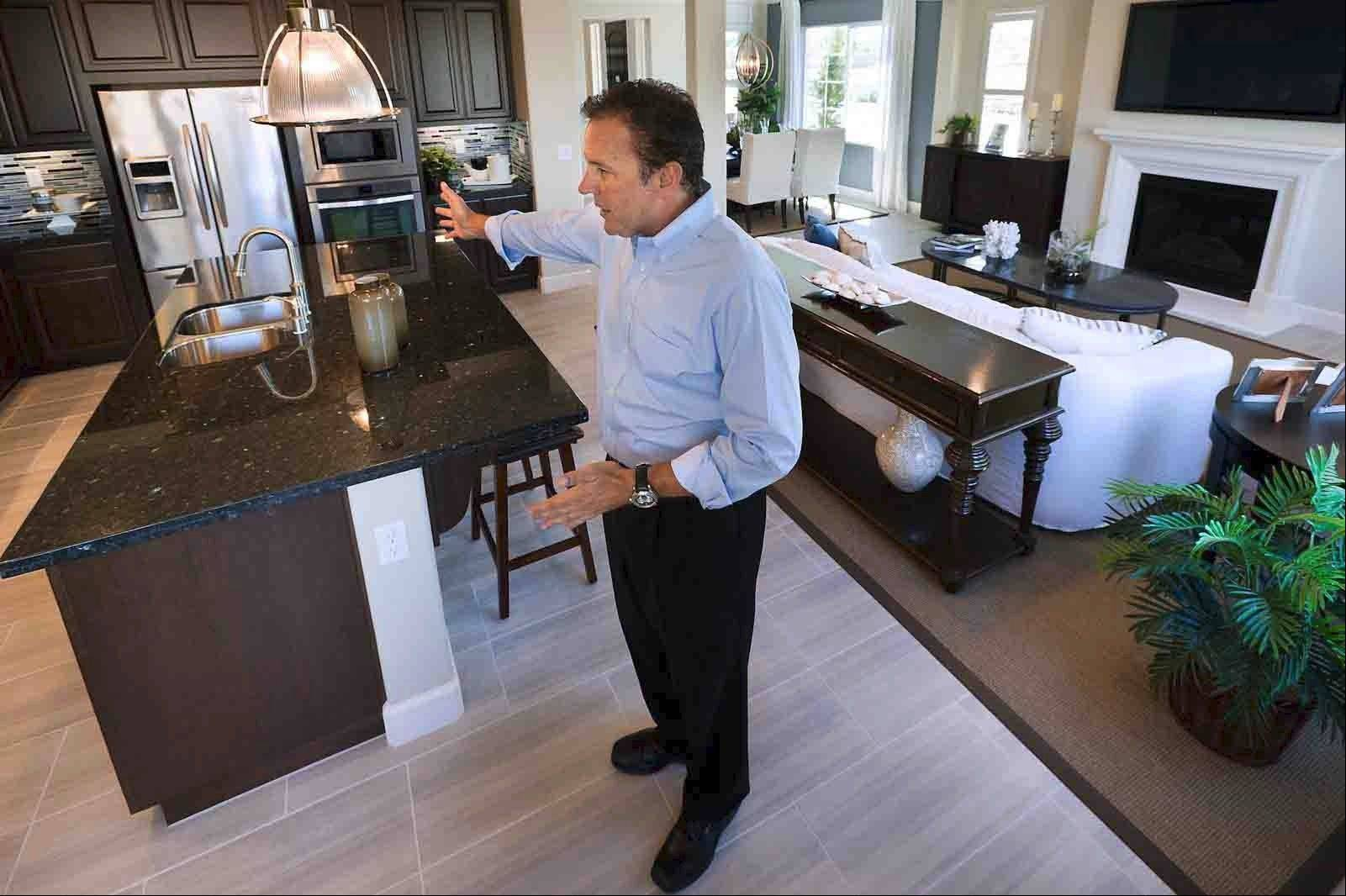 "Jeffrey Lake of Standard Pacific Homes said great rooms are the No. 1 request of new-home buyers. ""Everybody ends up in the kitchen, so why not make room for them?"""